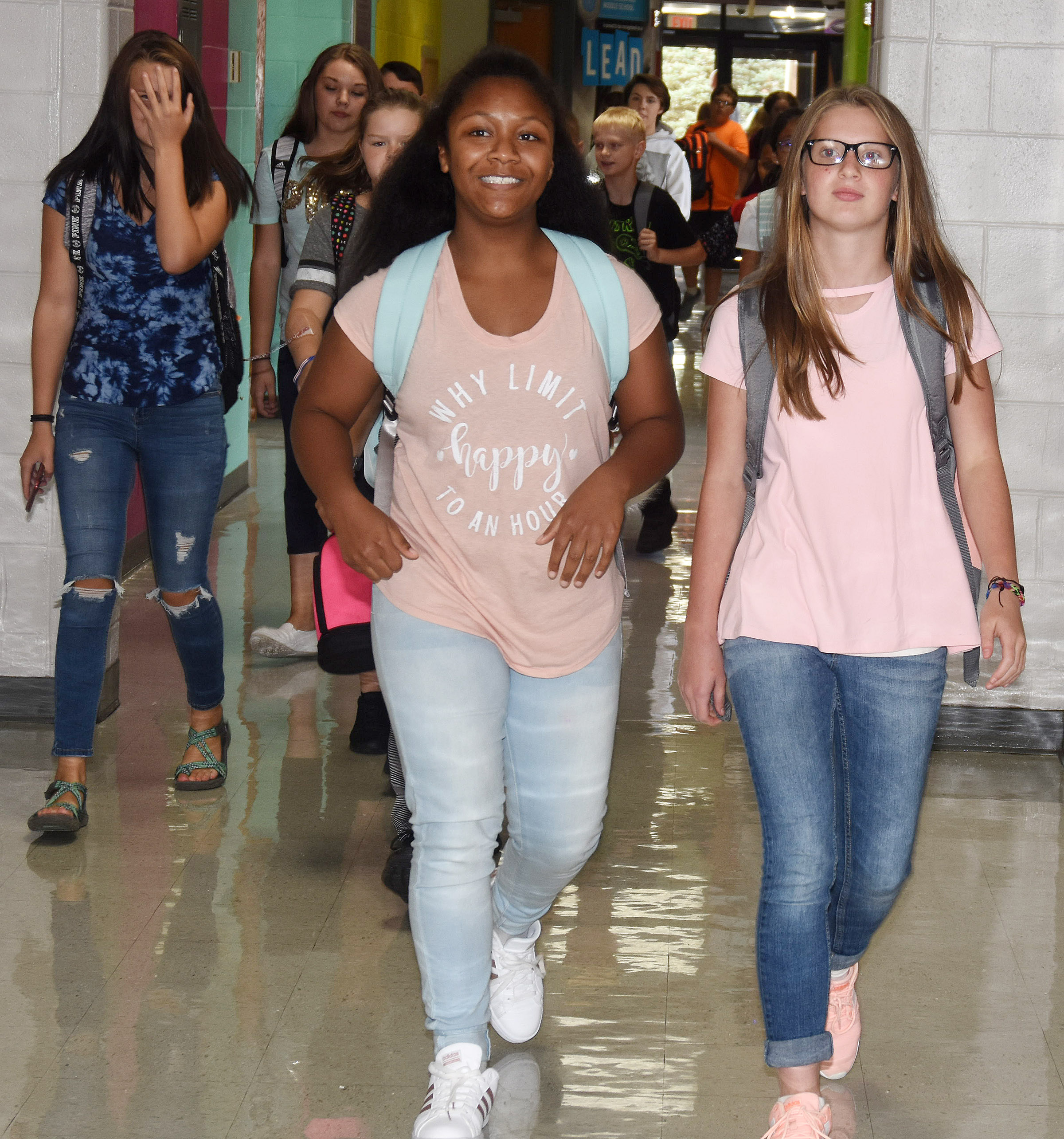 Campbellsville Middle School seventh-graders Camilla Taylor, at left, and Hannah Singleton walk to the buses at the end of the day.