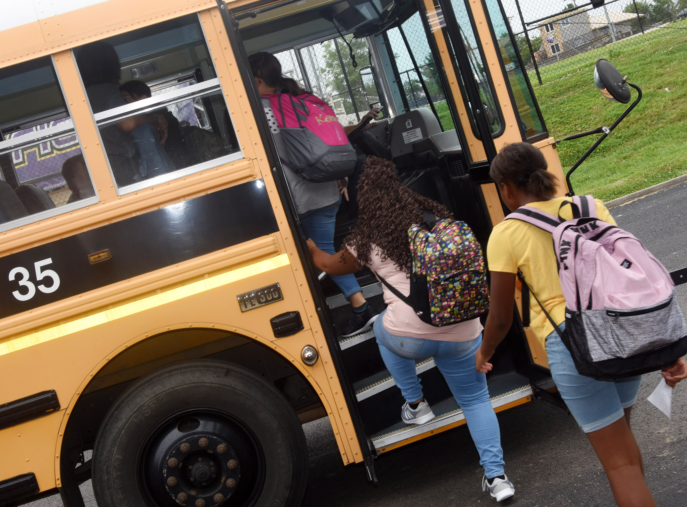 Campbellsville Middle School students catch the bus at the end of the day.
