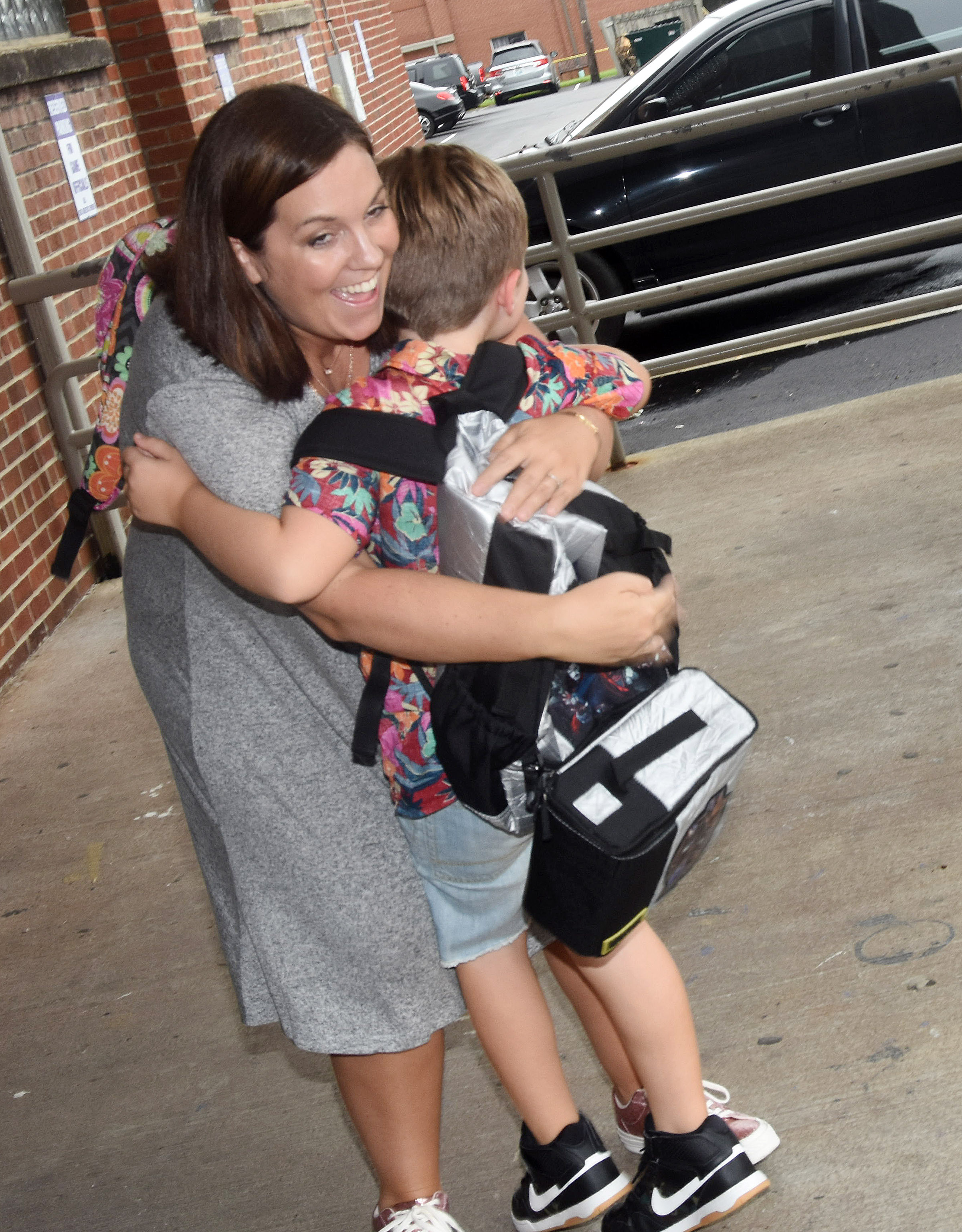 Campbellsville High School teacher Lindsay Williams hugs her son Gavin, a second-grader at Campbellsville Elementary School, as he gets off the bus at the end of the day.