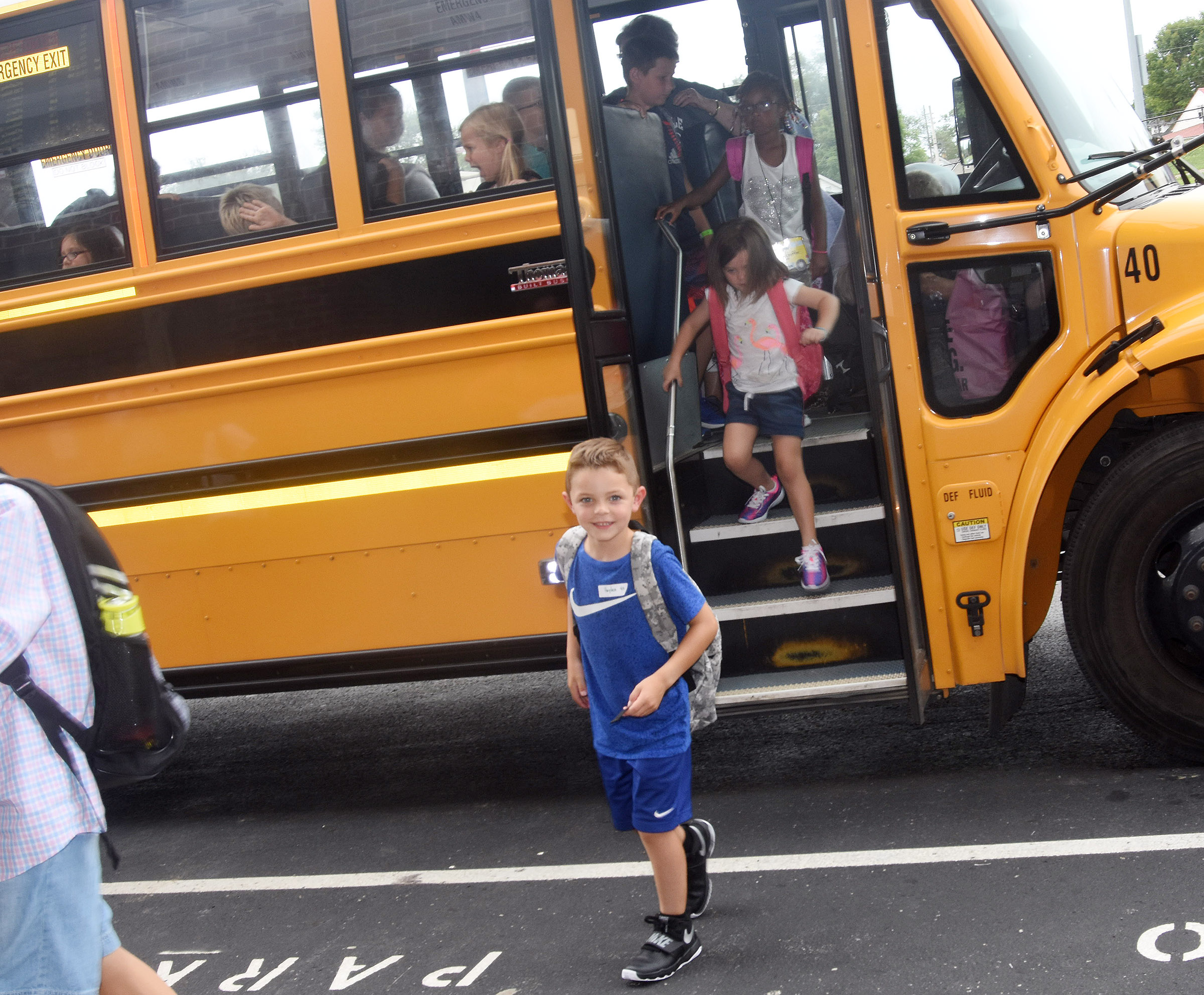 Campbellsville Elementary School first-grader Hayden Goff smiles as he gets off the bus at the end of the day.