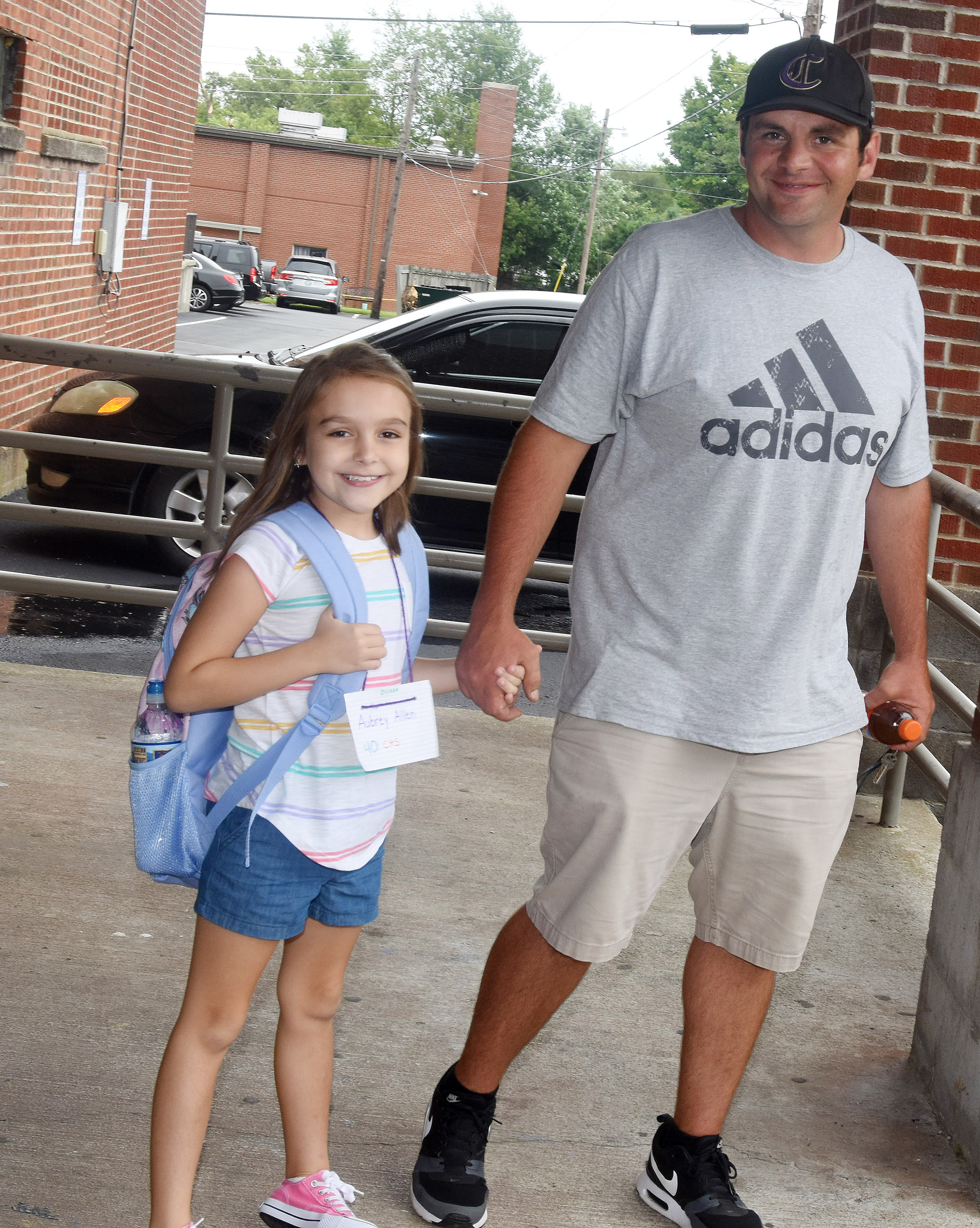 Campbellsville Elementary School second-grader Aubrey Allen smiles with her father, Tommy, the head custodian at Campbellsville High School, at the end of the school day.
