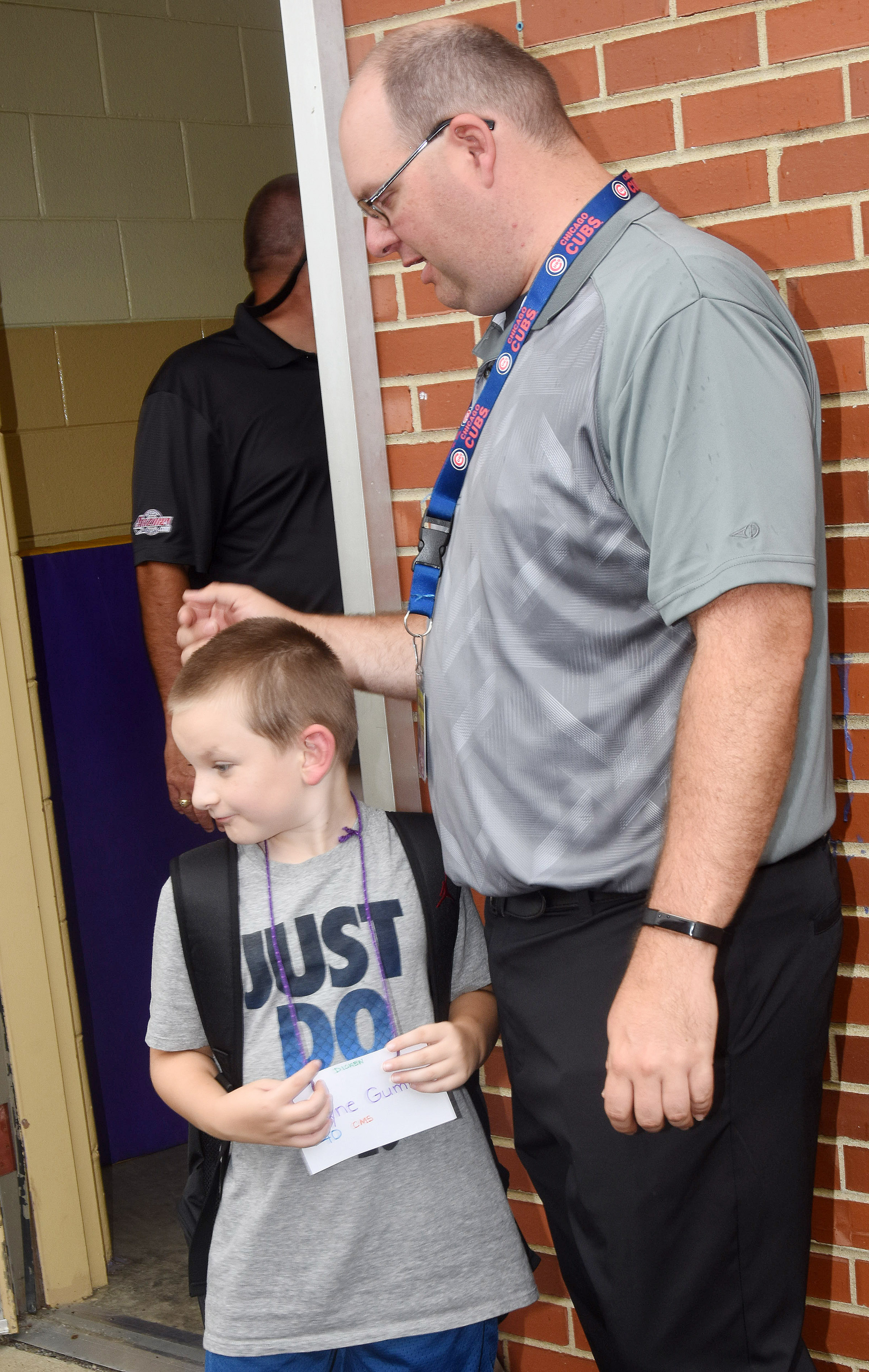 Campbellsville Middle School teacher Steven Gumm greets his son Ryne after his first day of second grade at Campbellsville Elementary School.