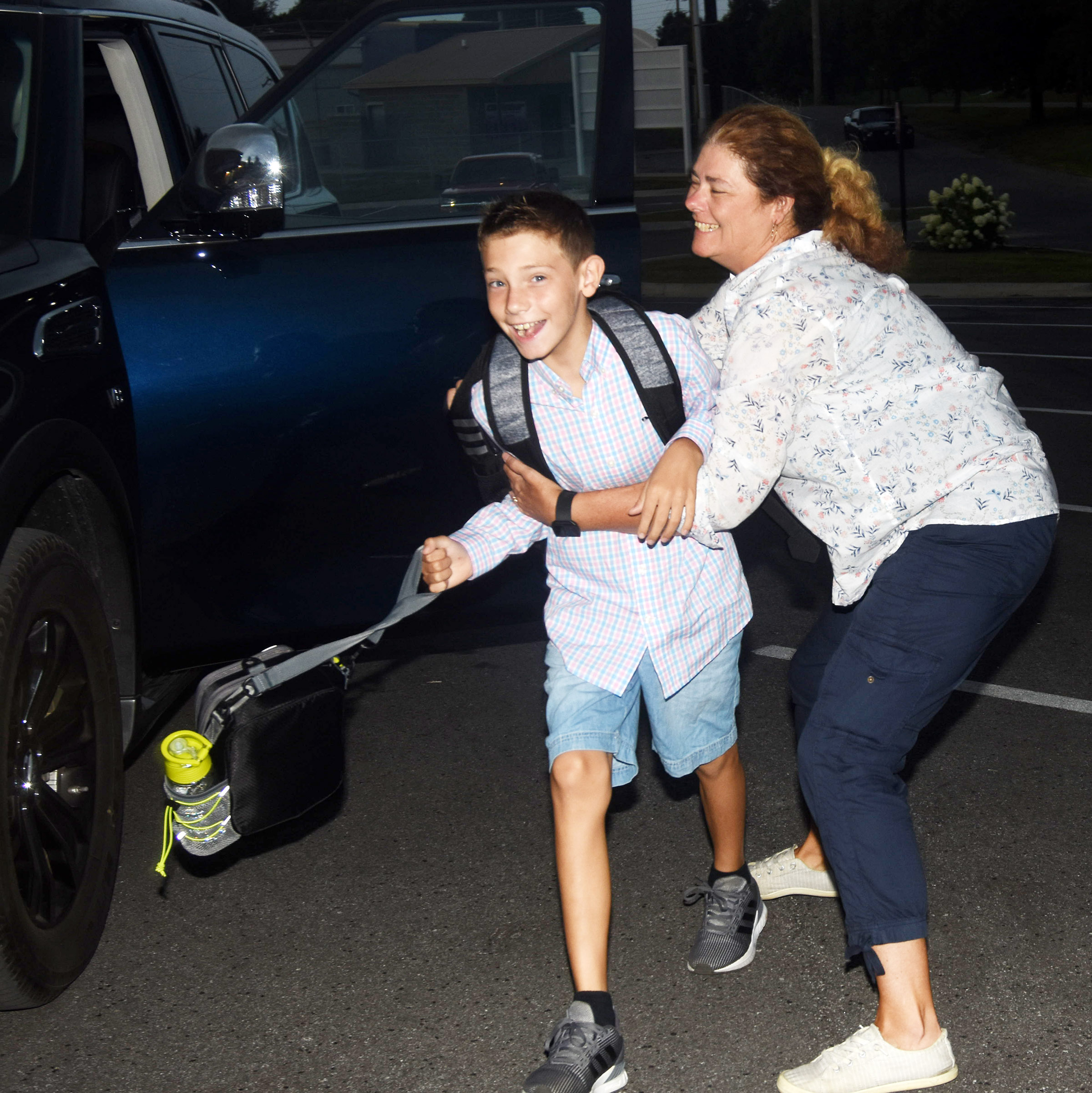 Campbellsville High School teacher Tammy Wilson grabs her son Aidan, a fourth-grader at Campbellsville Elementary School, for a hug as she drops him off for the first day of school.