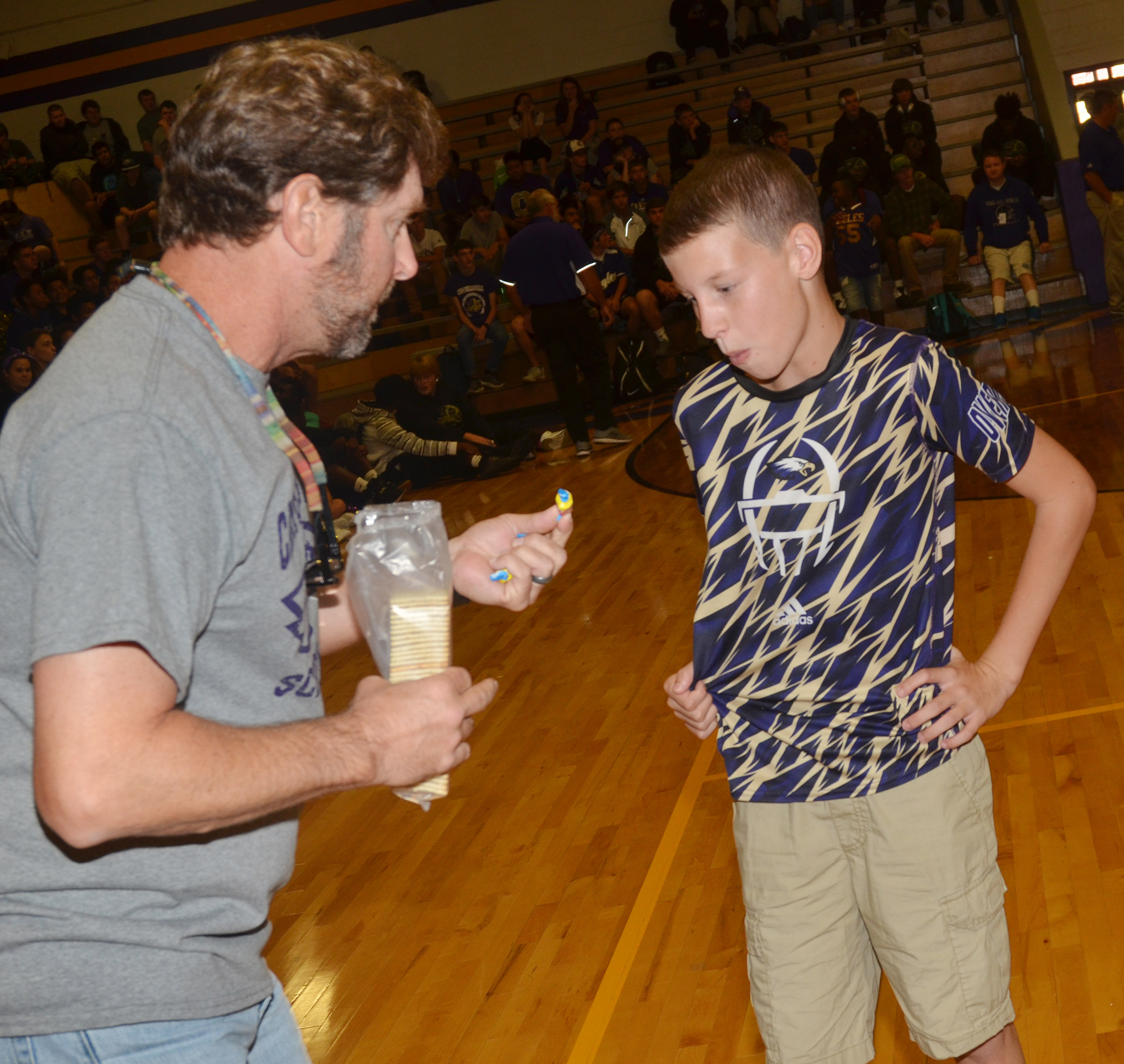 CES fifth-grader Rowan Petett eats a cracker during a spirit game.