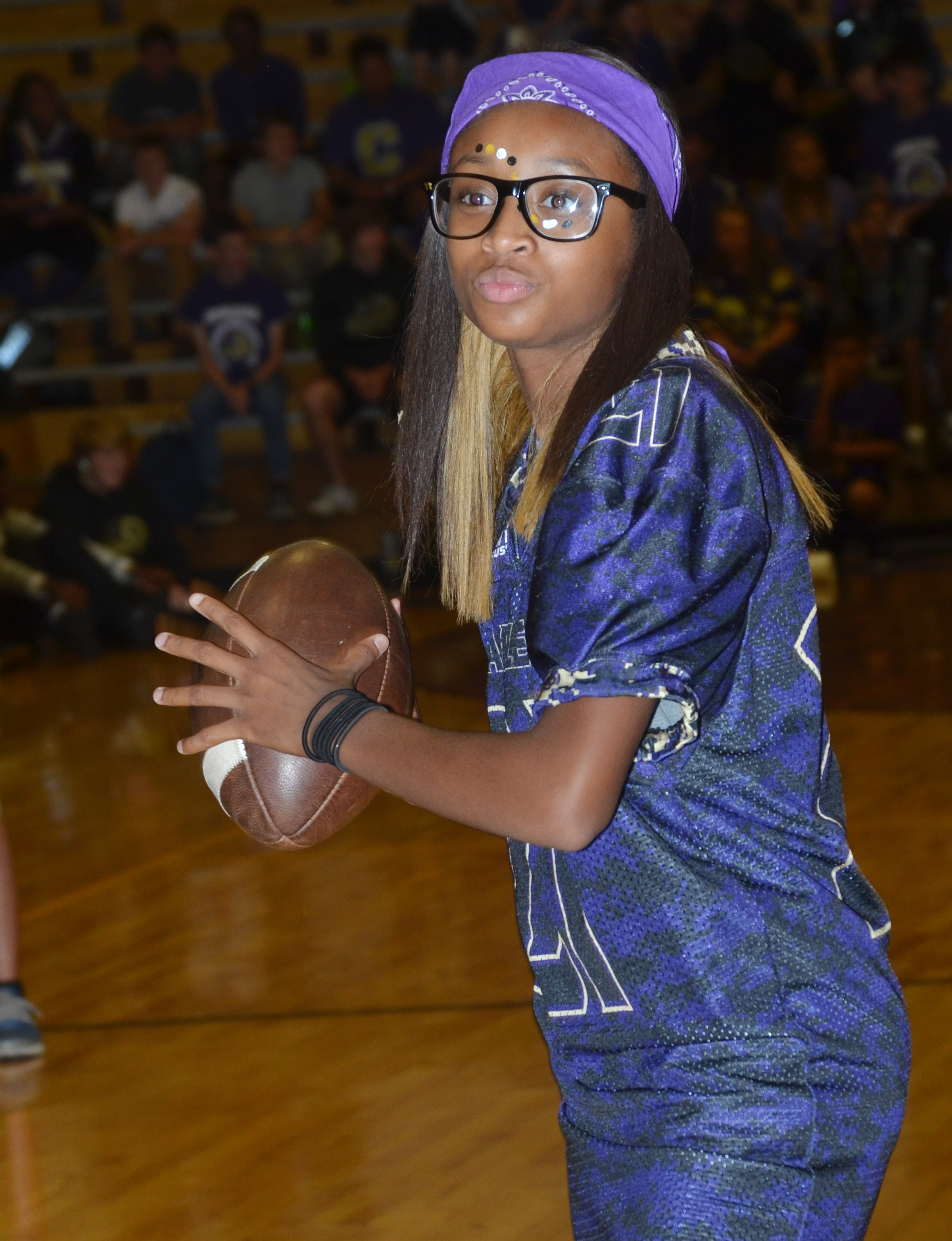 CMS eighth-grader Bri Gowdy throws a football in a spirit game.