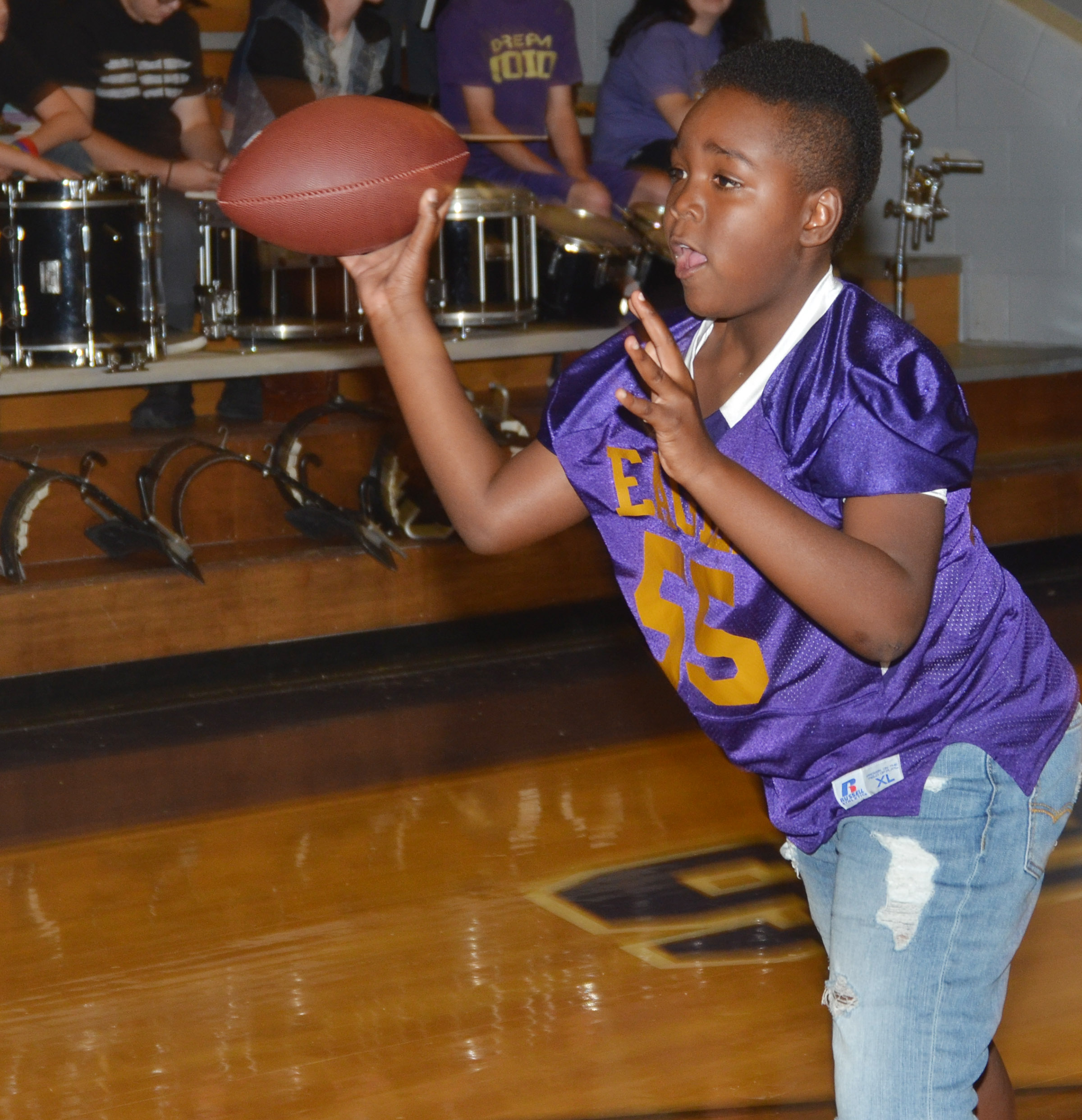 CES fifth-grader Deason Smith throws a football while playing a spirit game.