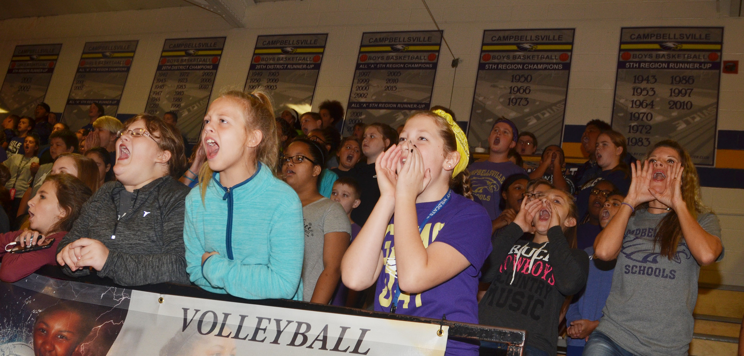 CMS students cheer as their classmates play a spirit game.