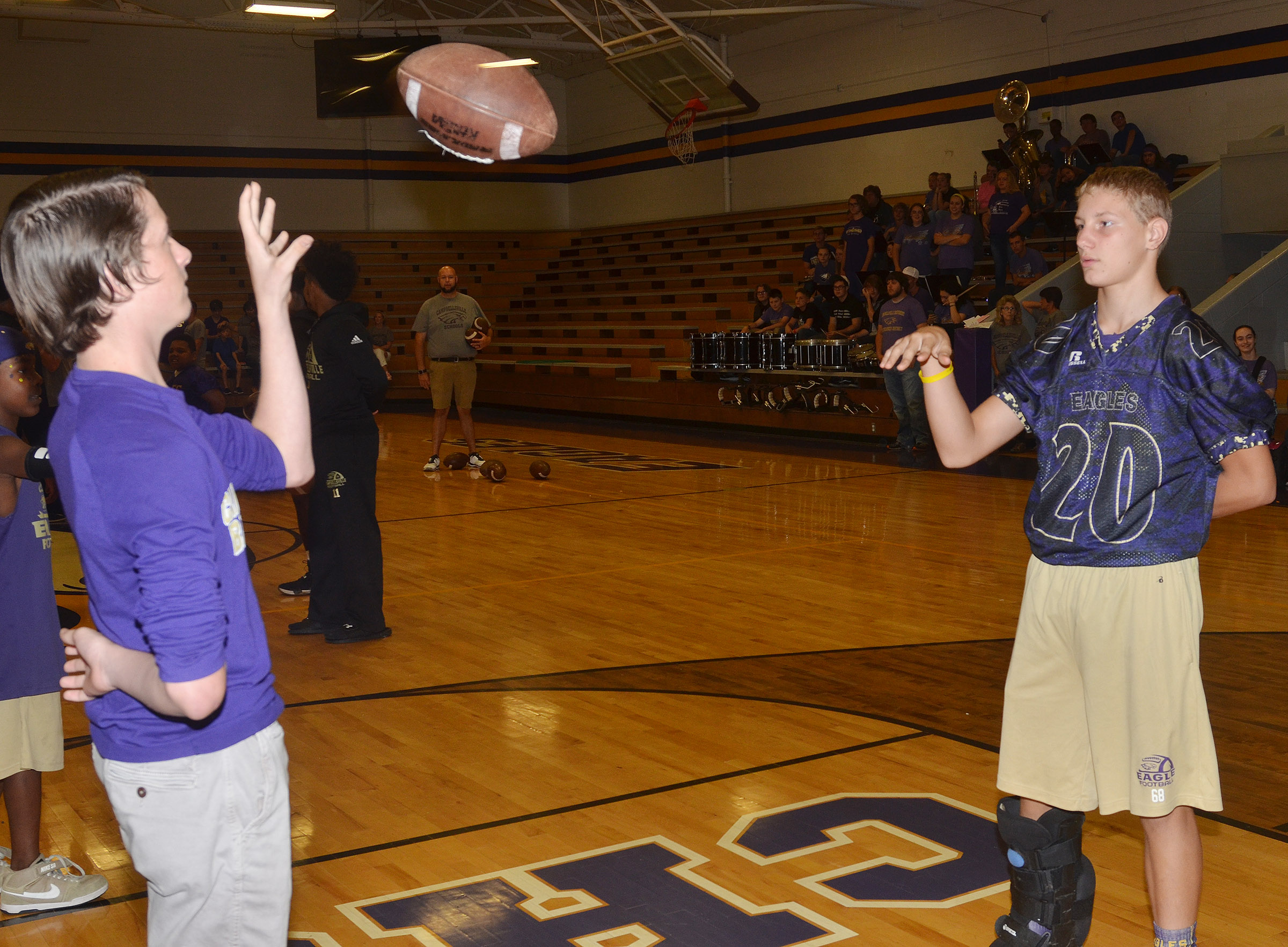 CMS seventh-grader Seth Hash, at left, and classmate Damon Johnson compete in a spirit game.