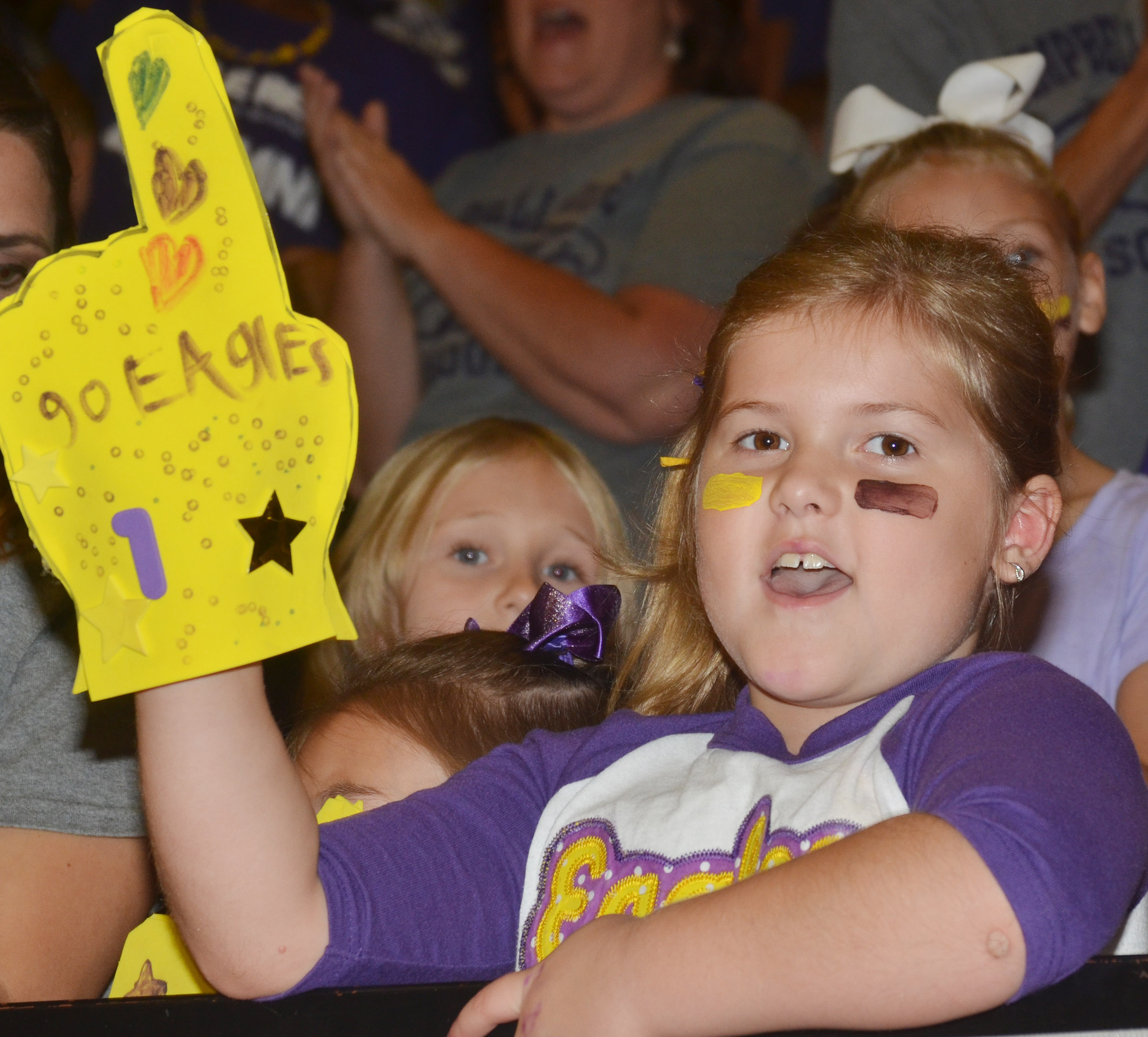 CES first-grader Aubreigh Knifley cheers for the Eagles.