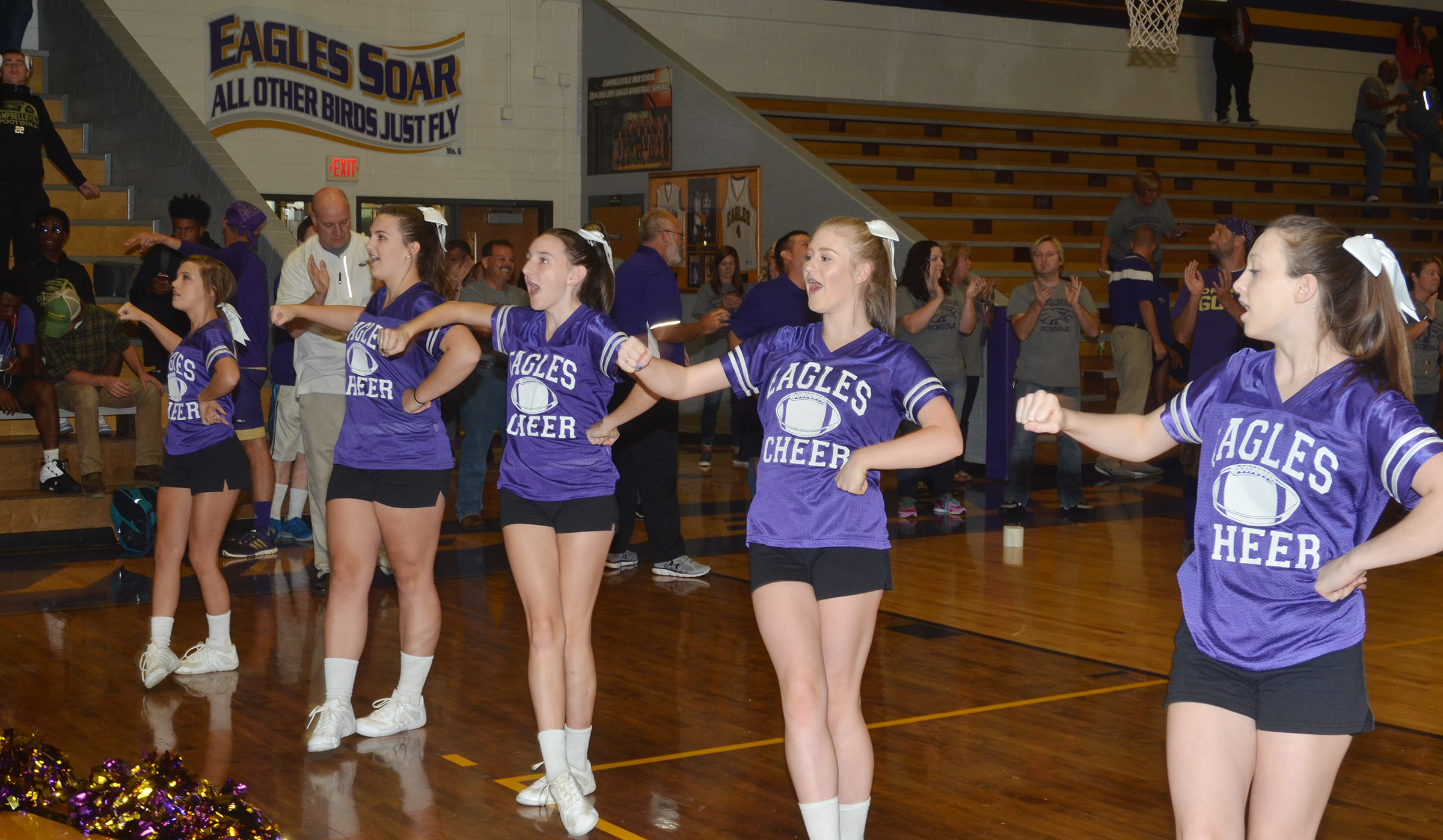 CHS cheerleaders lead their classmates in a cheer. From left are freshman Carly Adams, sophomores Haley Morris, Zoe McAninch and Isabella Osborne and junior Caleigh Bright.