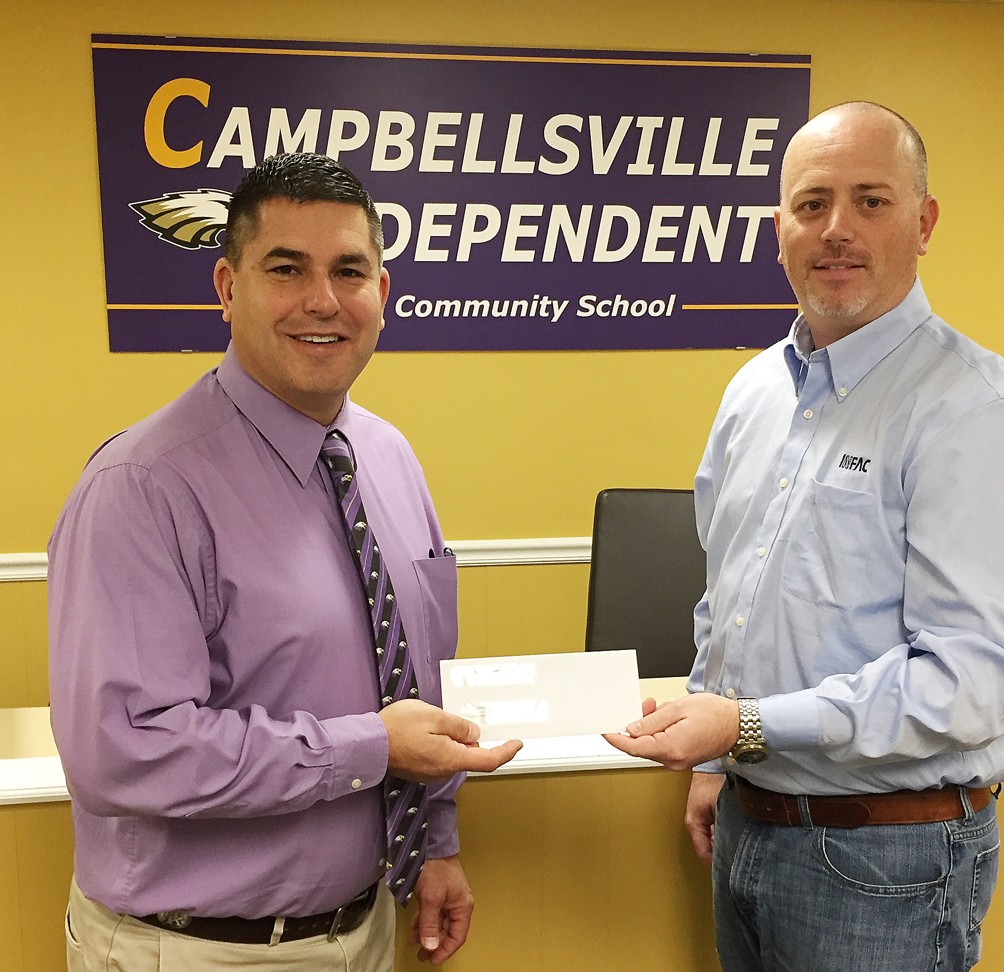 INFAC North America recently donated $2,000 to Campbellsville Independent Schools. Brian Bland, general manager, at right, made the presentation. Superintendent Kirby Smith, at left, accepted the donation on behalf of Campbellsville Independent Schools.