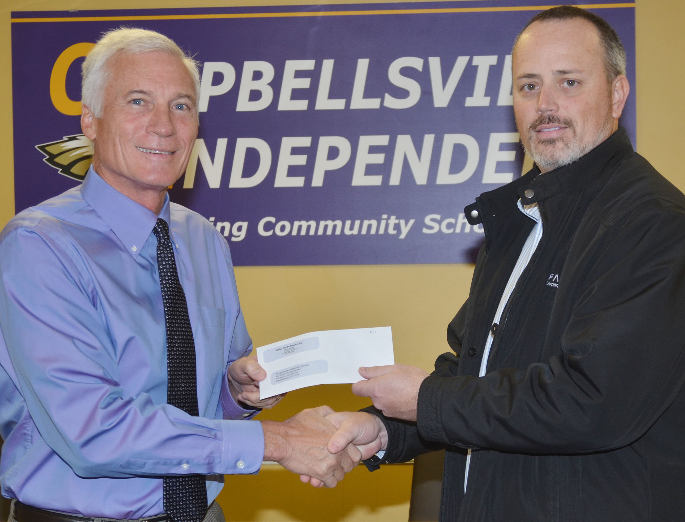 INFAC North America recently donated $2,000 to Campbellsville Independent Schools. Brian Bland, general manager, at right, made the presentation. Superintendent Mike Deaton, at left, accepted the donation on behalf of Campbellsville Independent Schools.