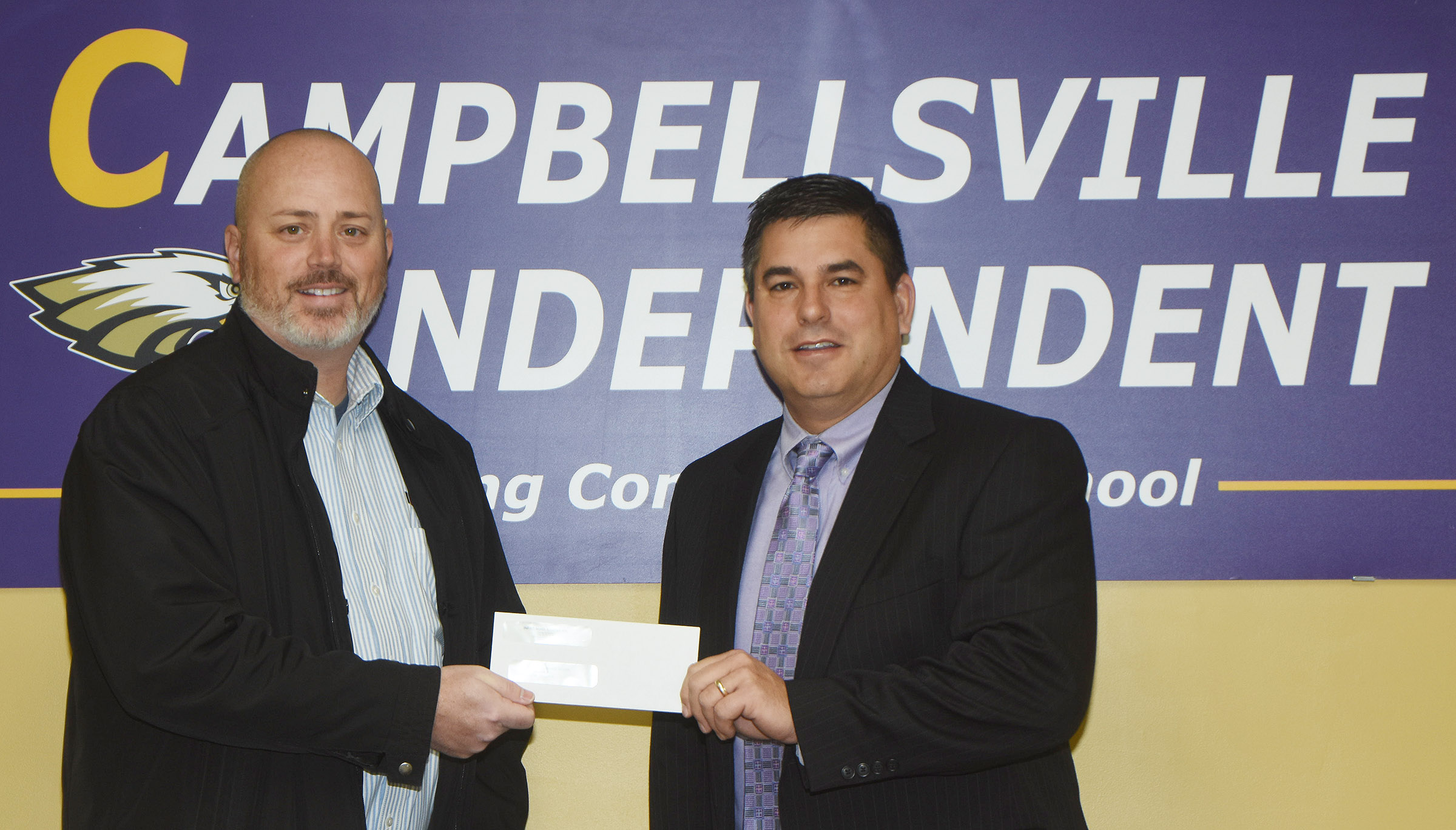 INFAC North America recently donated $2,000 to Campbellsville Independent Schools. Brian Bland, general manager, at left, made the presentation. Superintendent Kirby Smith accepted the donation on behalf of Campbellsville Independent Schools.