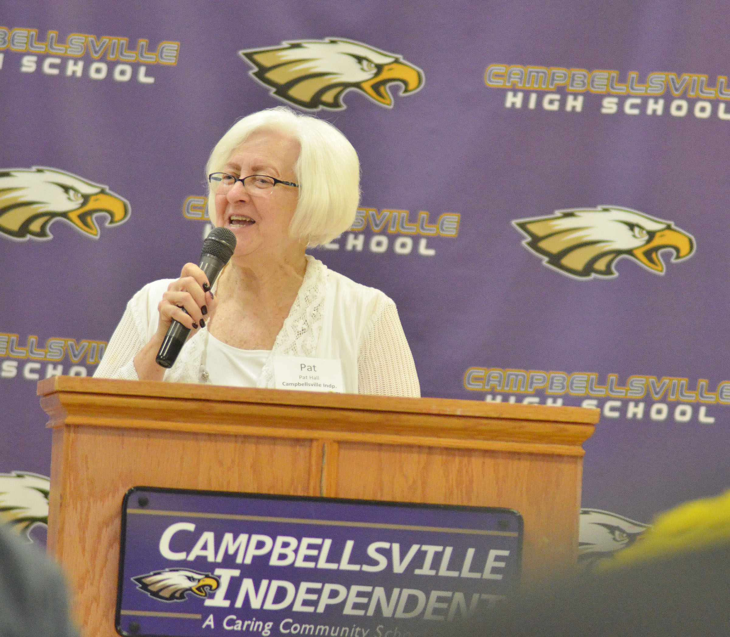 Campbellsville Board of Education Chair Pat Hall, who also serves as KSBA regional chairperson, welcomes those in attendance to Campbellsville High School.