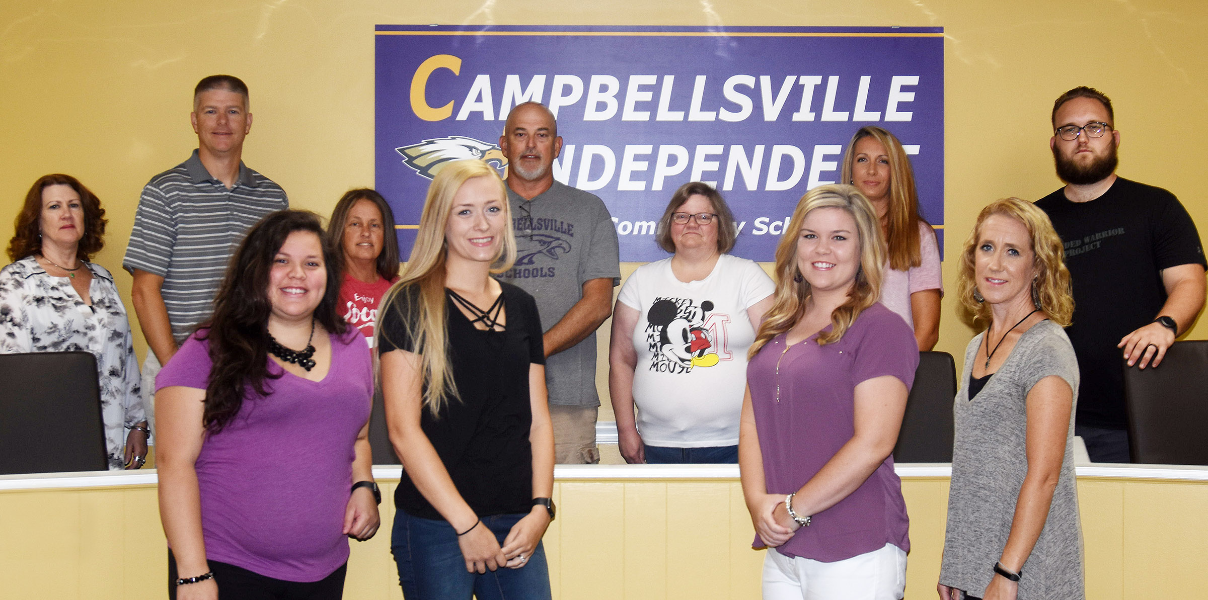 Campbellsville Independent Schools recently added 11 employees to the Eagle family. From left, front, are Carla Delgado, Eagle Academy instructional assistant at Campbellsville Middle School; Tesa Novak, preschool assistant at Campbellsville Elementary School; Alison LaRue, fifth-grade teacher at CES; and Lori Mitchell, exceptional child education instructional assistant at CES. Back, preschool assistant at CES; Doug Holmes, Wings Express director at CES; Vicki Brock, cafeteria worker at Campbellsville High School; Dean Faulkner, maintenance worker; Teresa Thompson, bus monitor; Misty Clark Matney, adult education instructor; and Jonathan McCoy, custodial worker.