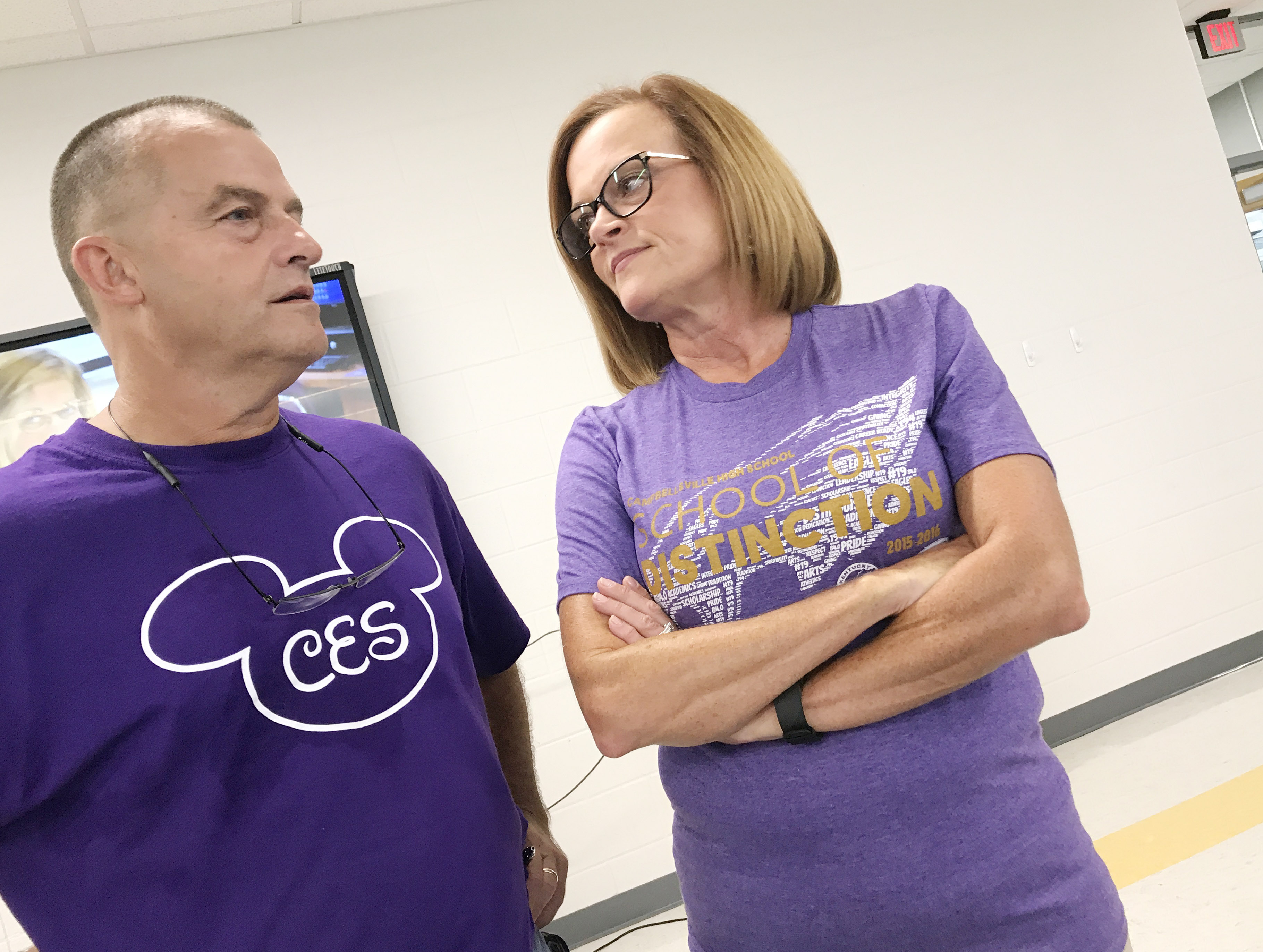 CES physical education teacher Lynn Kearney, at left, talks to CHS chemistry teacher Mary Jo Hazel during the opening day workshop for the 2017-2018 school year.