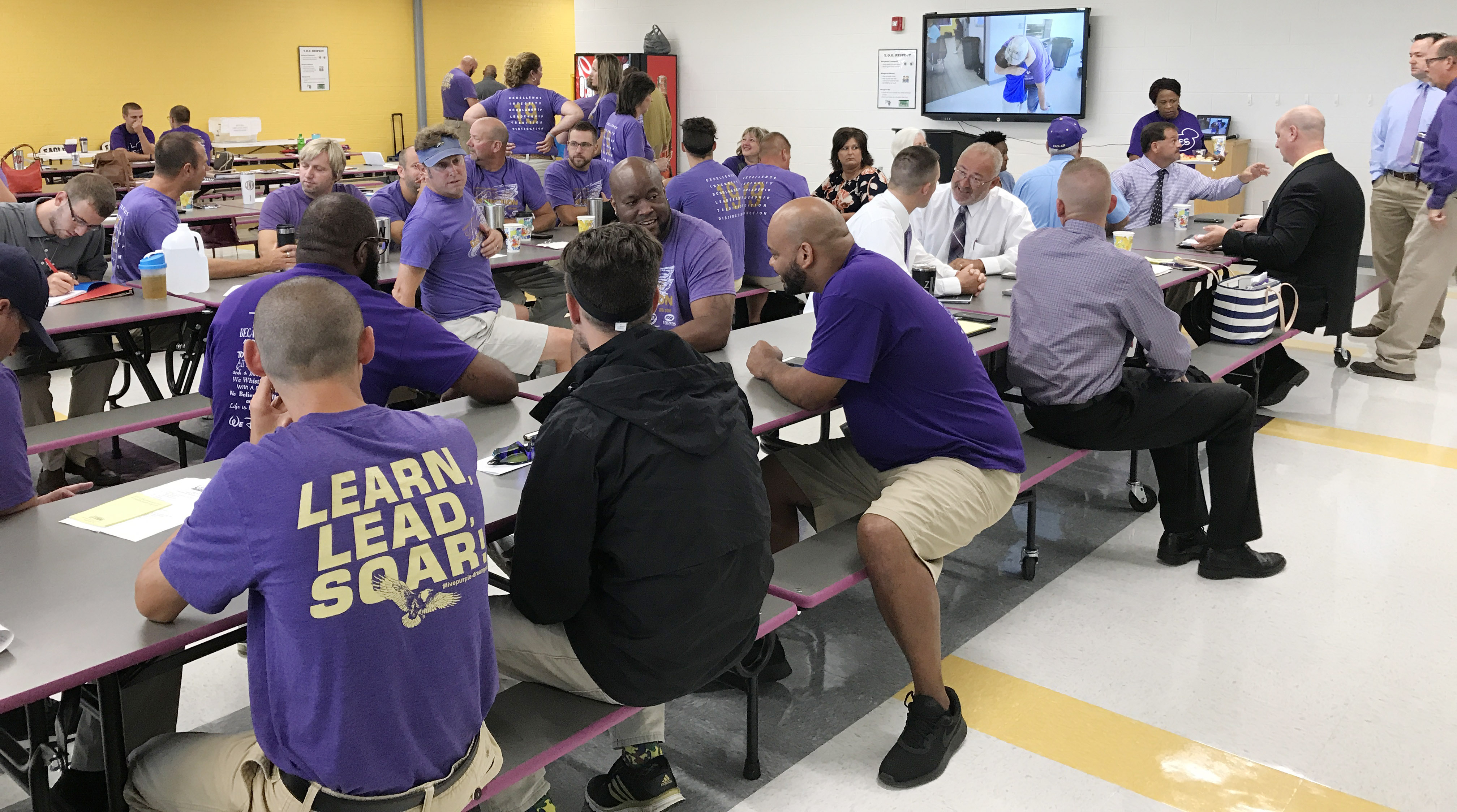 CIS employees join together for breakfast and fellowship during an opening day workshop for the 2017-2018 school year.