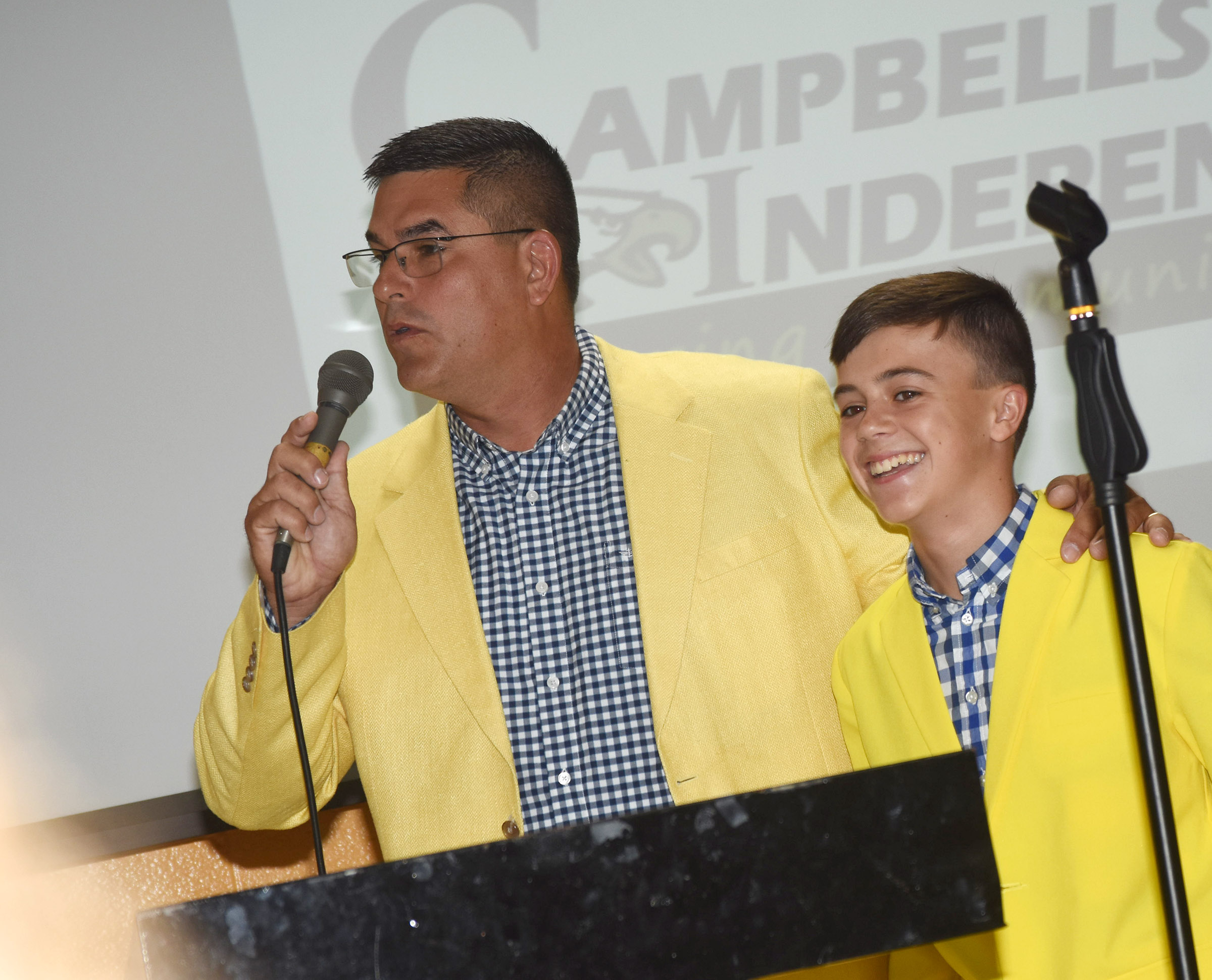 Campbellsville Independent Schools Superintendent Kirby Smith introduces Campbellsville Middle School eighth-grader Chase Hord, who was elected National Junior Beta secretary at the national convention this summer. After Hord was elected, CMS Beta Club students asked Smith to wear a yellow suit, like Hord wore during his campaign. Smith kept that promise during the opening day workshop. Hord led the opening prayer at the workshop.