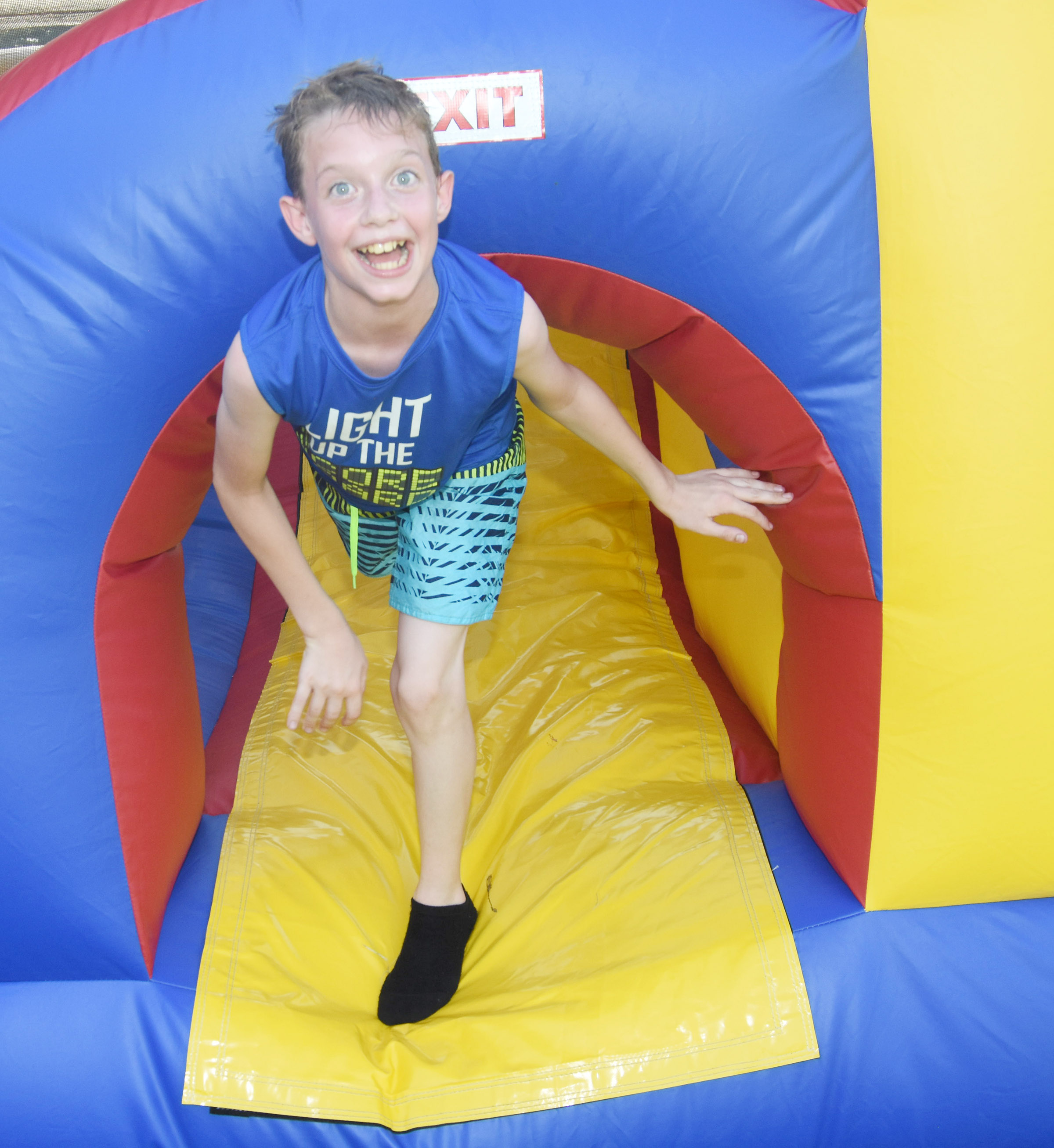 CMS sixth-grader Will Wooley runs through the bounce house.