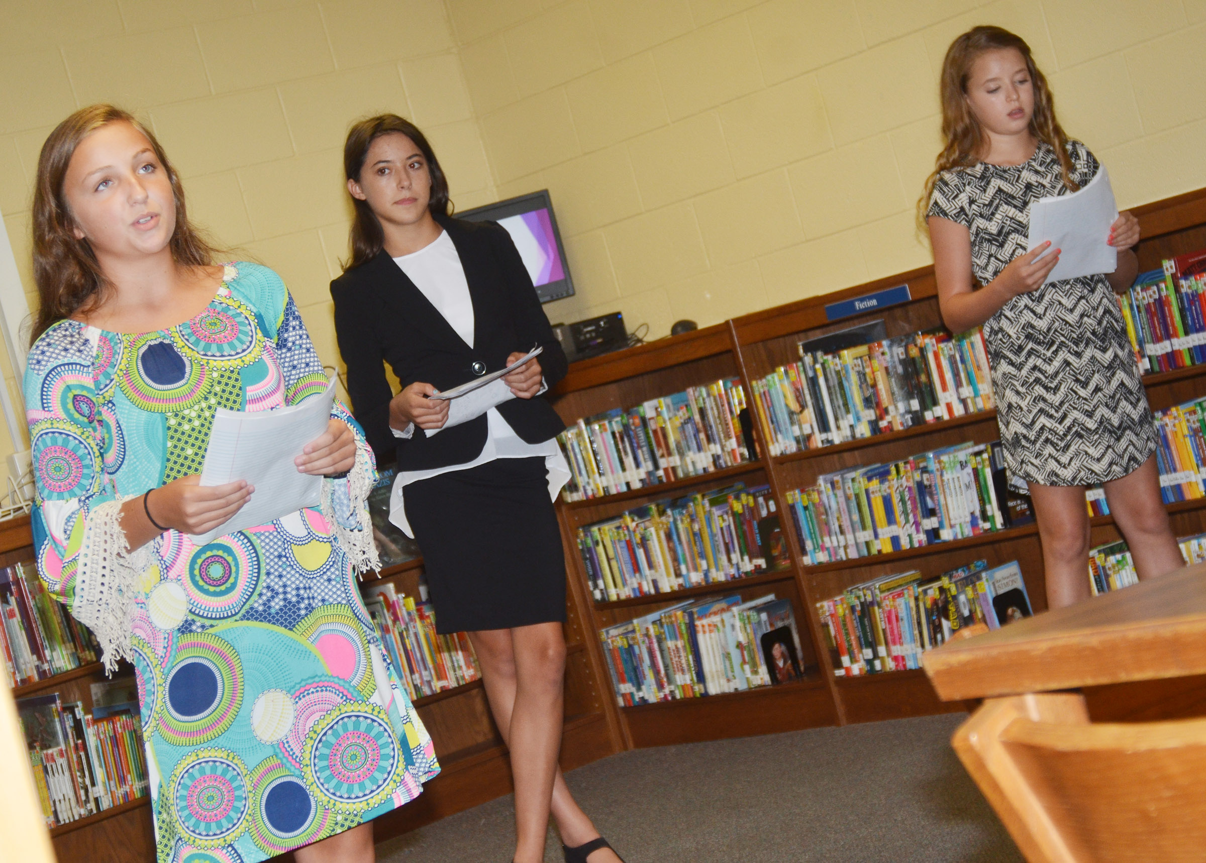 CMS eighth-graders, from left, Lainey Watson, Kaylyn Smith and Rylee Petett talk about how the Leader in Me program at CMS has changed their lives.