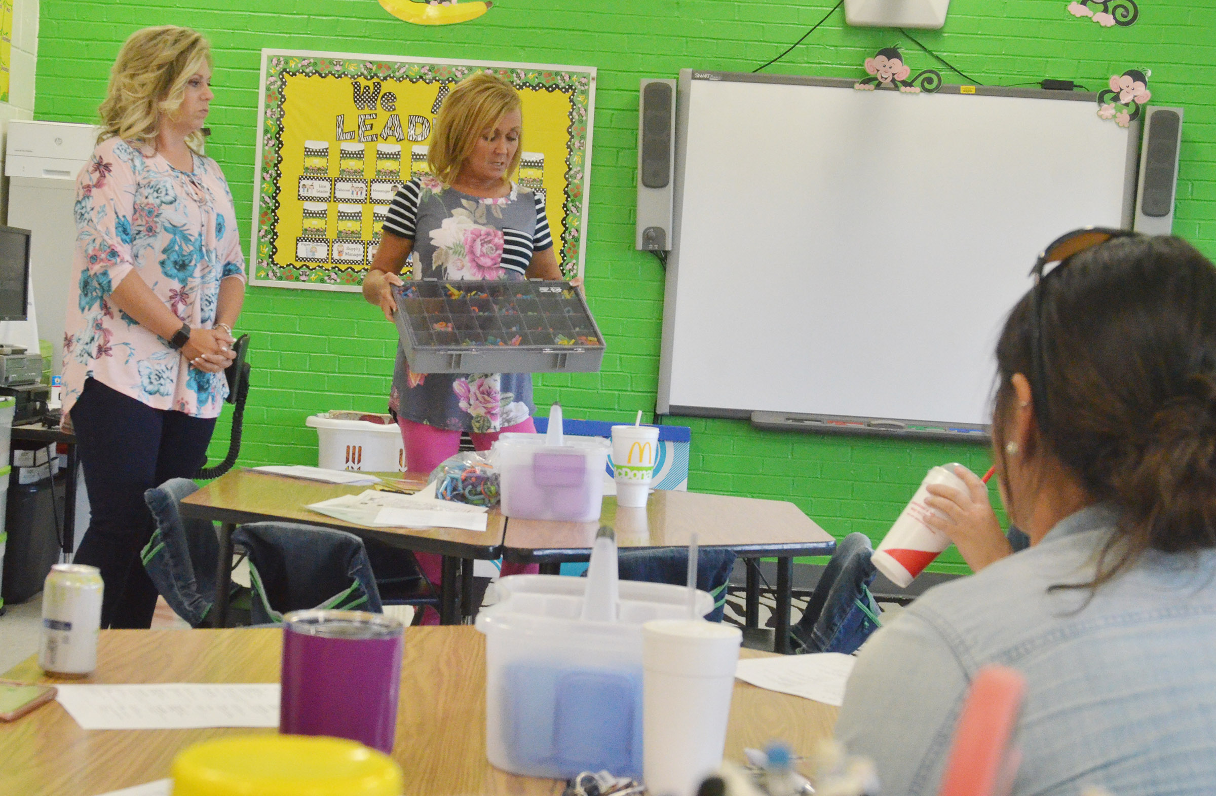 CES kindergarten teachers Nikki Price, at left, and Lisa Wiseman talk about using centers in the classroom.