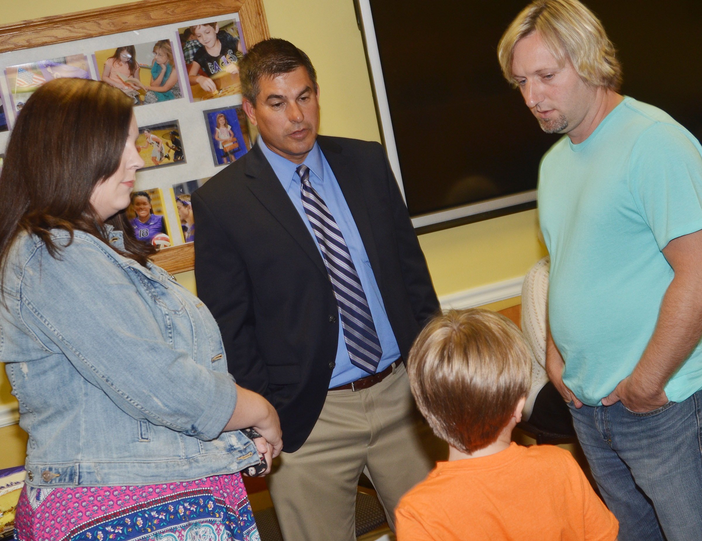 Superintendent Kirby Smith talks with Lindsay and David Williams and their son, Gavin, who will be a first-grader at CES. Lindsay Williams teaches English and David Williams is a virtual instructor at CHS.