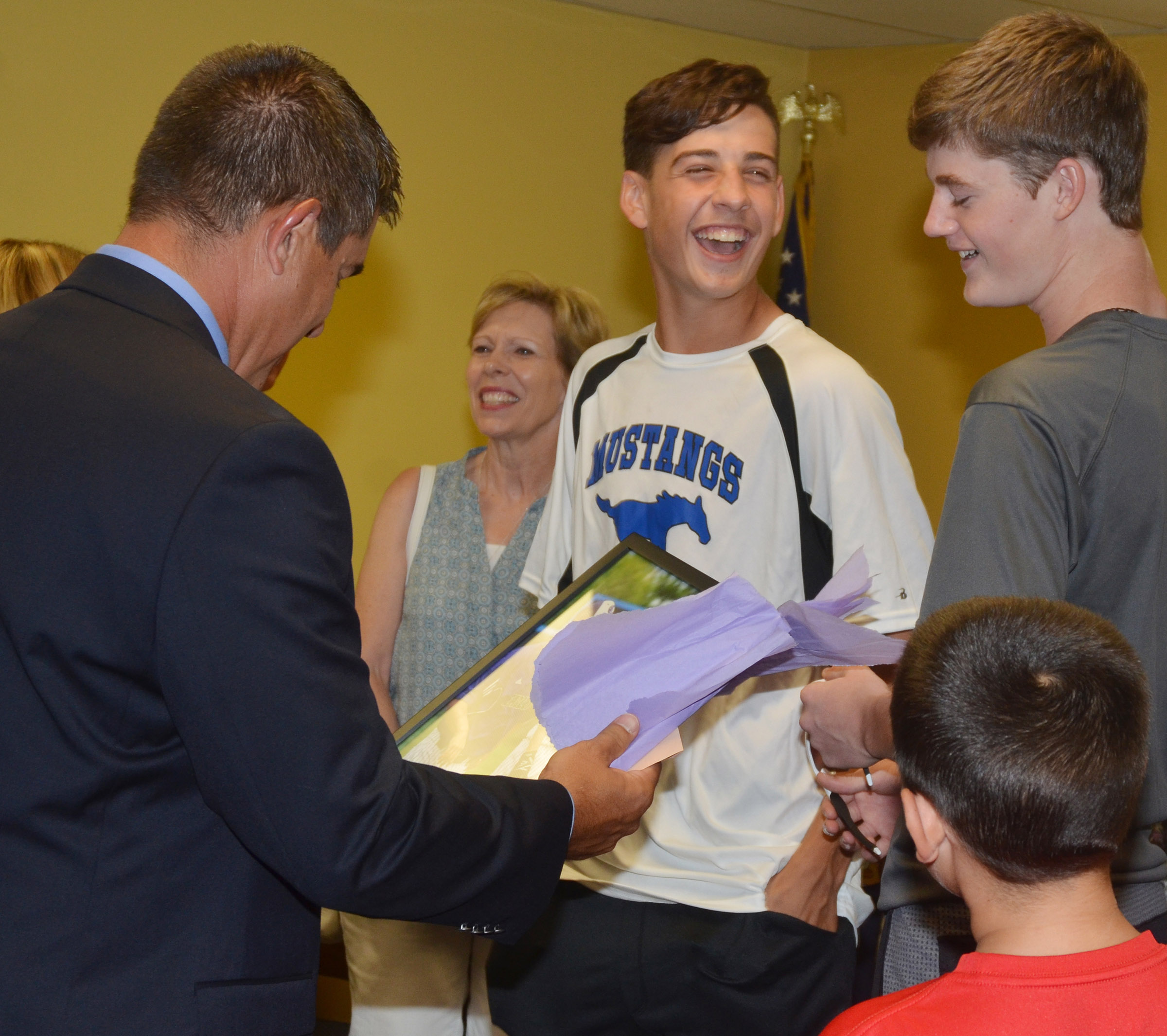 CHS freshmen John Orberson, center, and Tristin Faulkner talk with their former baseball coach, Kirby Smith, who is now superintendent. Orberson gave Smith a photo taken of the two of them during a game.