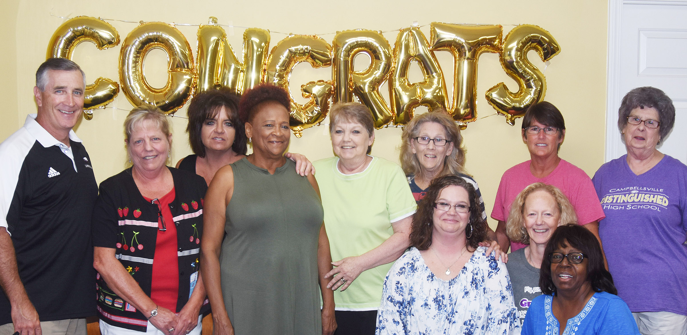 Jeff Richardson, director of pupil personnel and food service, retired last month and was honored on Monday, July 30, during a special luncheon. Richardson, at left, is pictured with the CIS food service workers. From left are Gilly Beard, Shelly Wilson, Lavada Gaddie, Eveleen Burkhead, Mildred Beard, Tina Pike, Bobbi Faulkner, Lois Lacy, Ruth Allen and Laura Taylor.
