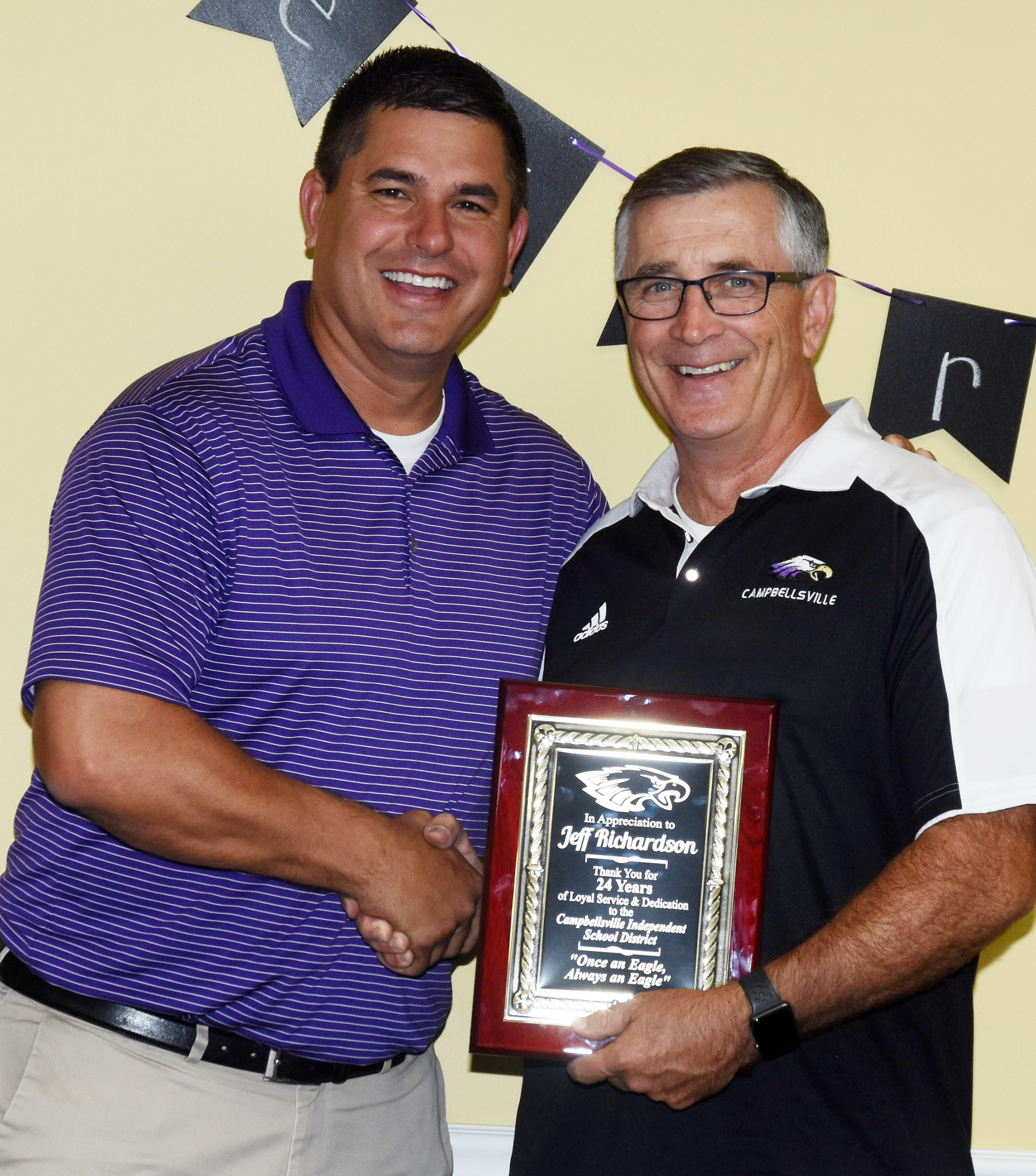Jeff Richardson, director of pupil personnel and food service, retired last month and was honored on Monday, July 30, during a special luncheon. Richardson, at right, is honored by CIS Superintendent Kirby Smith.
