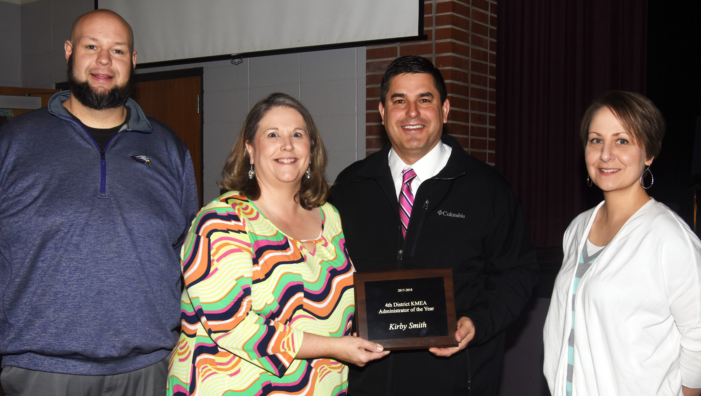 Campbellsville Independent Schools Superintendent Kirby Smith has received 4th District Kentucky Music Educators Association Administrator of the Year award for 2017-2018. Campbellsville High School band director Zach Shelton, at left, nominated Smith for the award, and he and Campbellsville Elementary School music teacher Cyndi Chadwick, second from left, and Campbellsville Middle School music teacher Jessica Floyd, at right, spoke at the 4th District fall meeting about how Smith strongly supports all the CIS arts programs.
