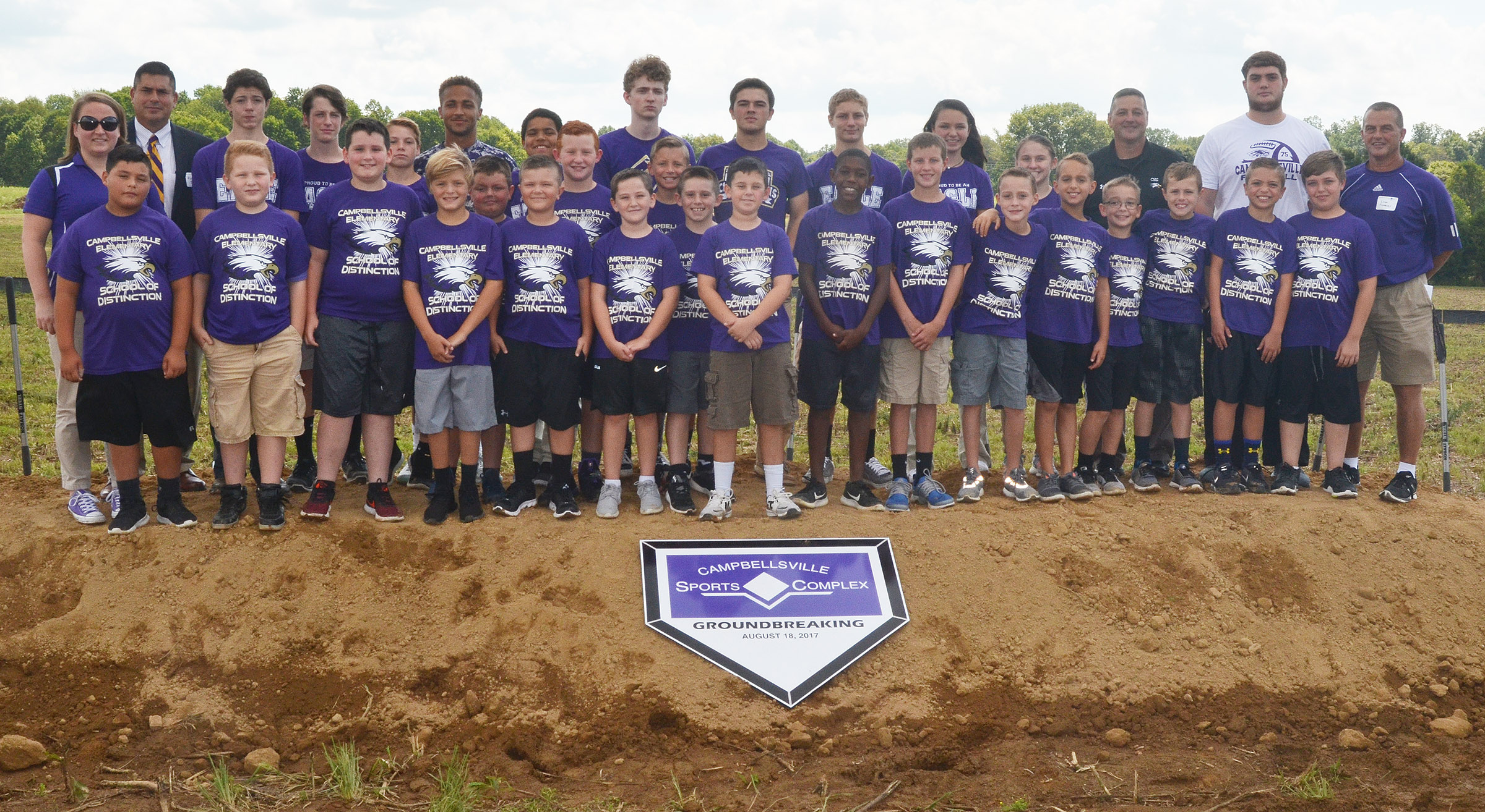 Campbellsville Independent Schools' students were a part of history on Friday, Aug. 18. Thirty students were on hand to participate in the groundbreaking of the Campbellsville Sports Complex. From left, front, are fourth-graders Brayden Paiz, Isaiah Jeffries and Ethan Garrison, third-graders Emerson Gowin, Hayden Maupin, Cayton Lawhorn, Reece Swafford and Luke Adkins, fourth-grader Cameron Taylor, third-graders Lanigan Price, Damien Clark and Jaron Johnson, fifth-grader Rowan Petett, fourth-graders Caysen Tungate, Bradley Paris, Cameron Estes, Keaton Hord and Carson Mills and fifth-grader Skylar Wilhoite. Back, CMS teacher Katie Campbell, CIS Superintendent Kirby Smith, eighth-grader C.J. Adams, seventh-grader Seth Hash, eighth-grader Tuff Harper, senior Ethan Lay, sixth-grader Tashuan Hart, juniors Jackson Hinton and Ryan Kearney, eighth-graders Damon Johnson and Karley Morris, seventh-grader Leigh Hicks, CHS Assistant Principal Mark Kearney, junior Lane Bottoms and CES teacher Lynn Kearney.