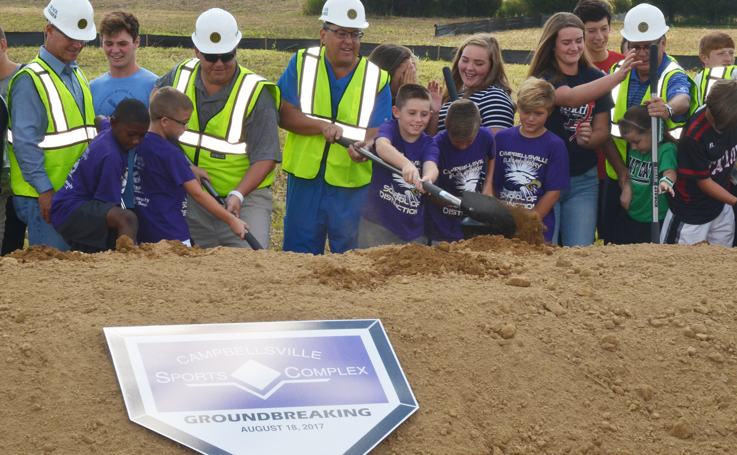From left, CES third-grader Jaron Johnson, fourth-grader Cameron Estes, third-grader Lanigan Price, fourth-grader Cameron Taylor and third-grader Emerson Gowin help break ground for the sports complex.