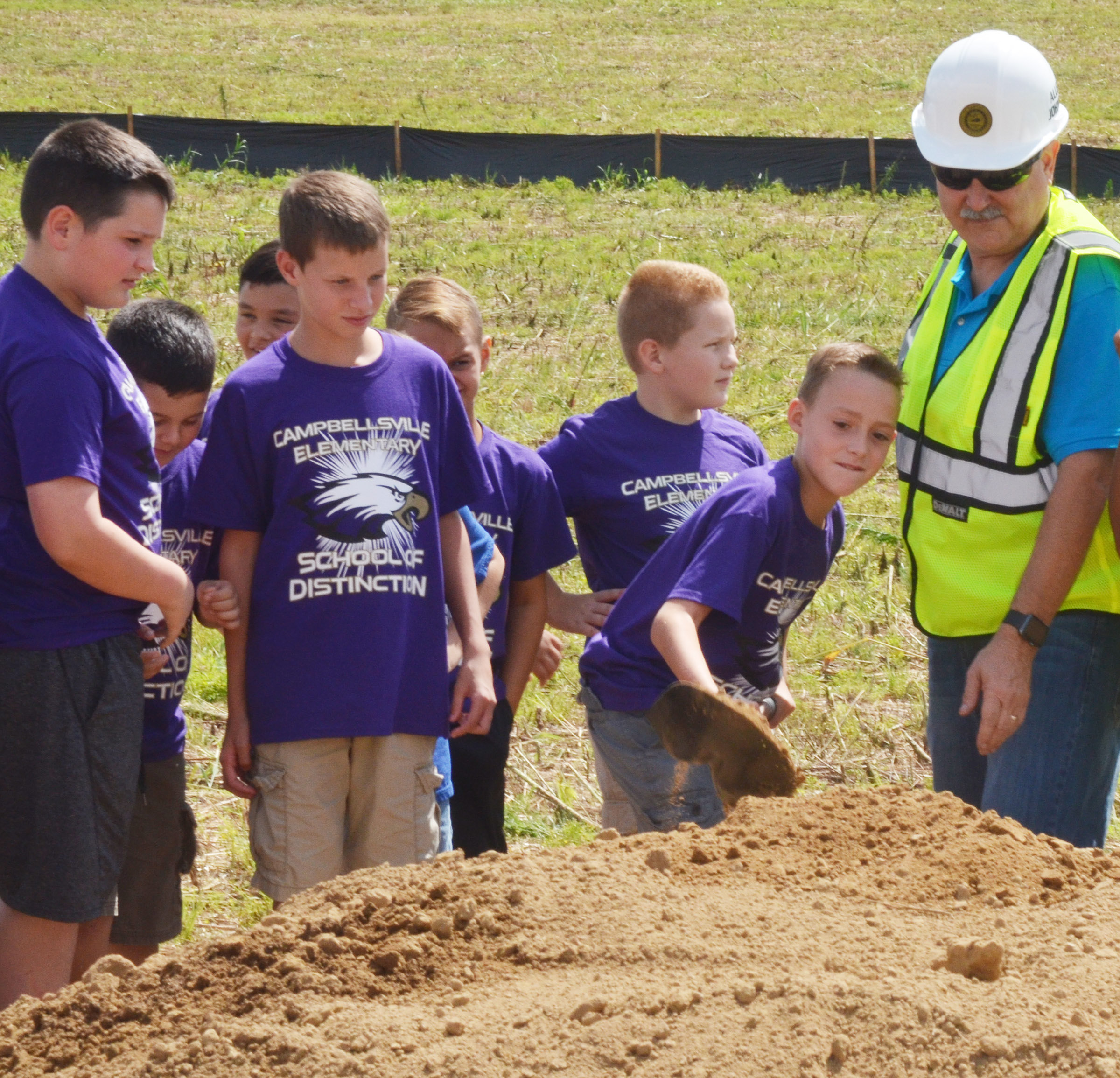 CES fourth-grader Caysen Tungate breaks ground for the sports complex with Campbellsville City Council member Allen Johnson.