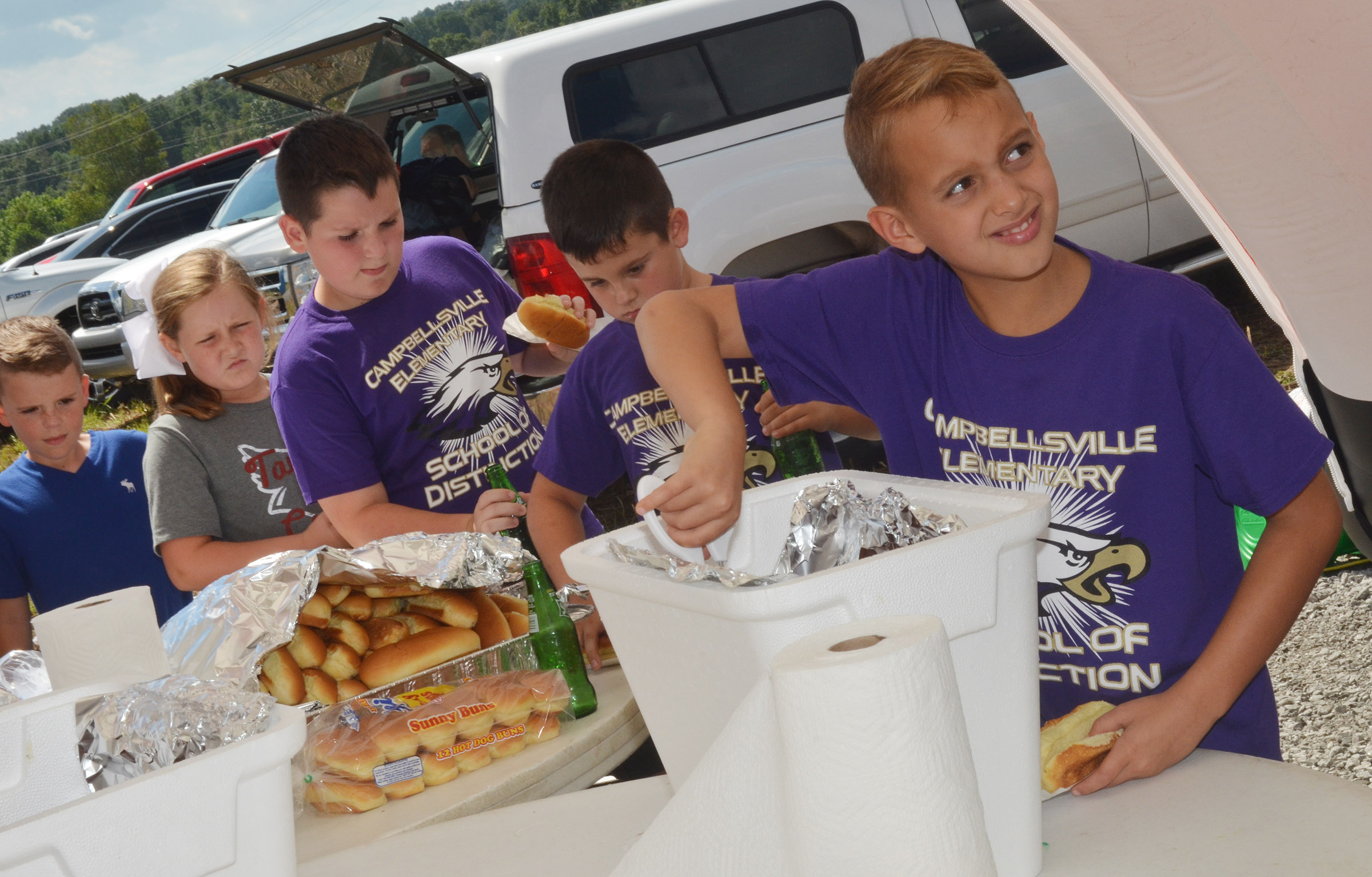 CES fourth-grader Bradley Paris gets a hot dog.