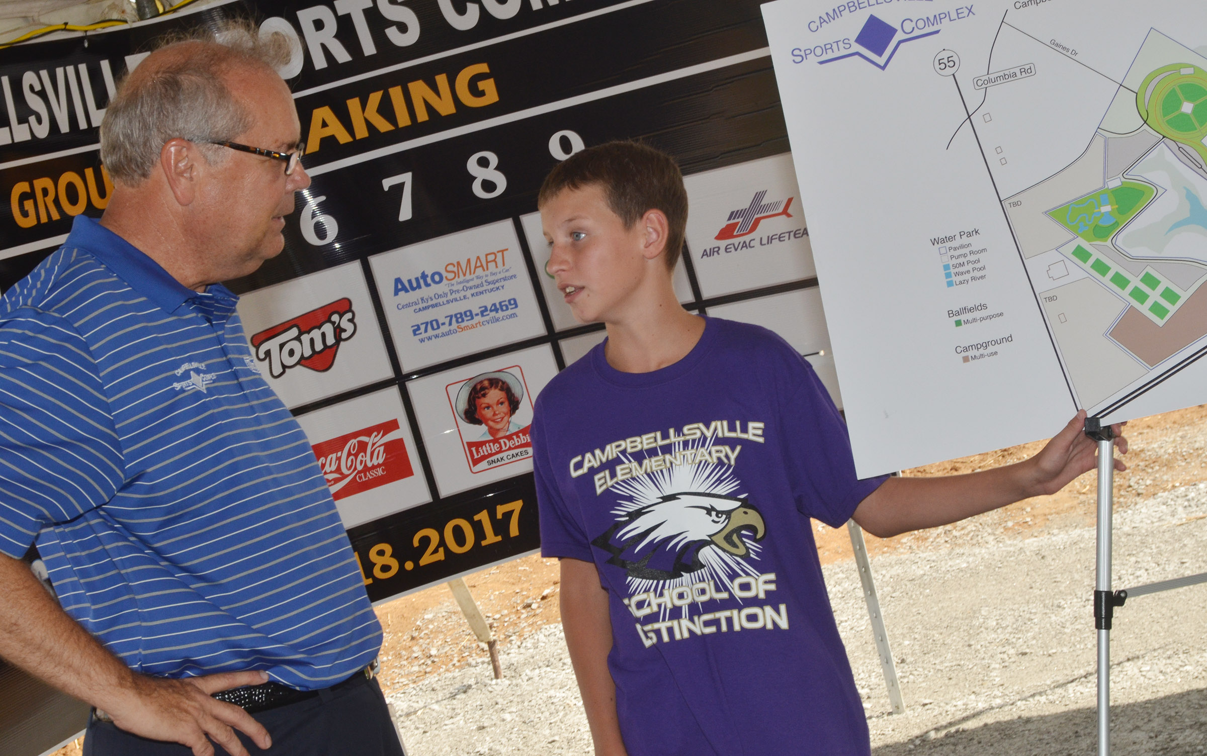 CES fifth-grader Rowan Petett talks to Campbellsville Mayor Tony Young about the new sports complex.