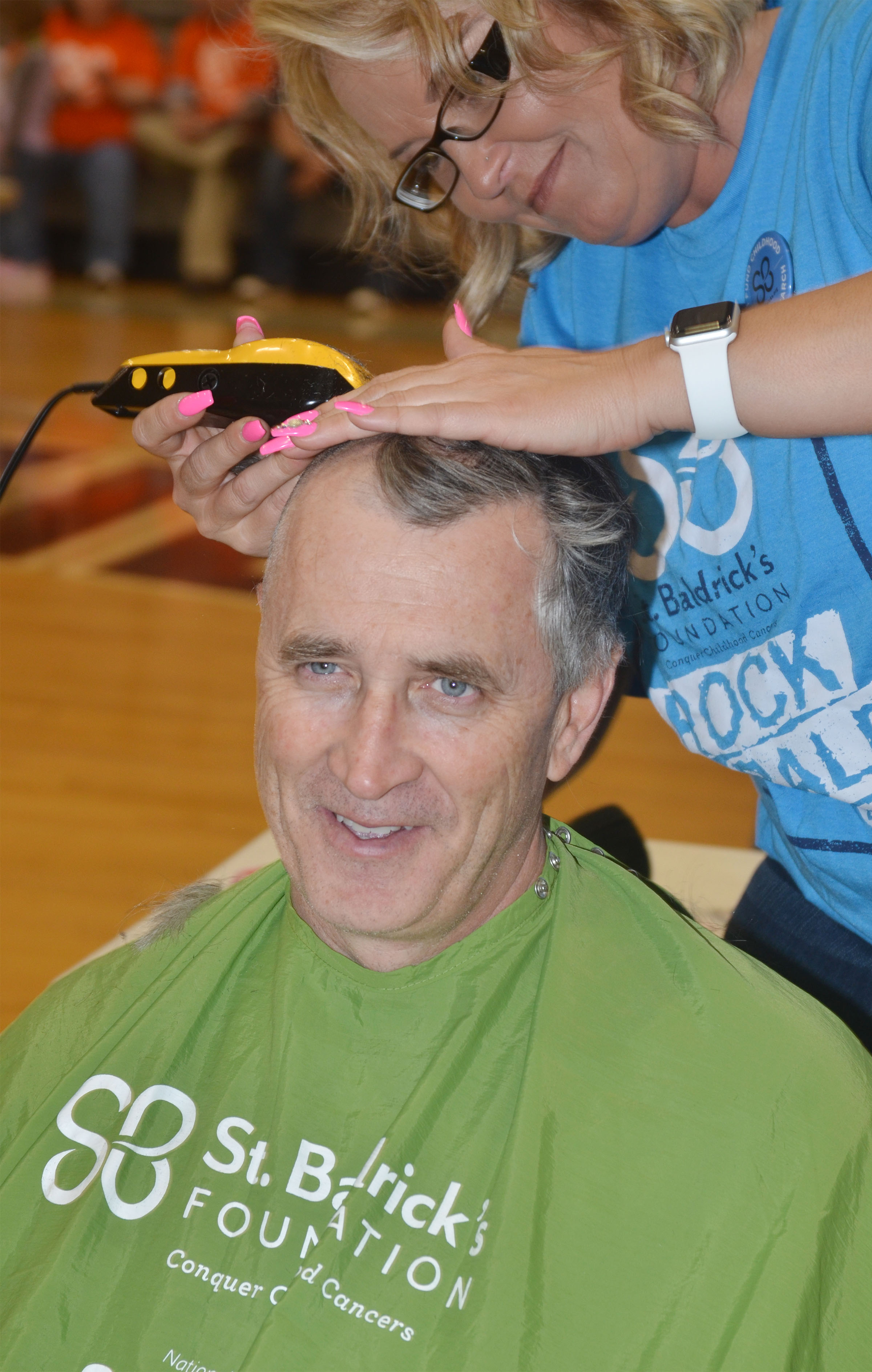 Director of Pupil Personnel/Food Services Jeff Richardson has his head shaved to raise money for children's cancer research.