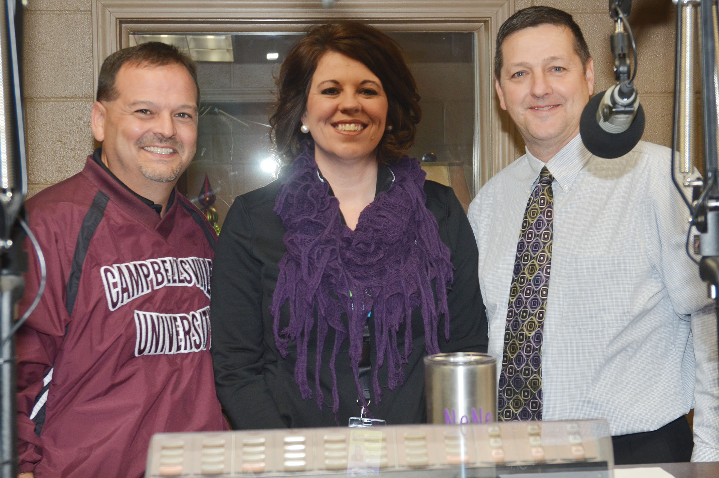 "From left, CES Principal Ricky Hunt, CMS Principal Elisha Rhodes and CHS Assistant Principal Mark ""Shiny"" Kearney participated in the annual Toys for Tots radiothon."