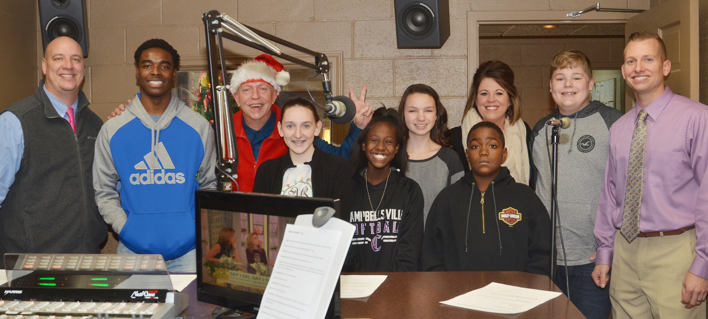Campbellsville Independent Schools' principals and students recently helped Q-104 raise money for the community's Toys for Tots fundraiser. From left are CHS Principal David Petett, CHS senior Chanson Atkinson, Q-104 radio personality Rob Collins, CHS sophomore Zoe McAninch, Campbellsville Middle School eighth-graders Myricle Gholston and Karley Morris, Campbellsville Elementary School fifth-grader Deason Smith, CES Principal Elisha Rhodes, CMS eighth-grader Blake Settle and CMS Principal Zach Lewis.