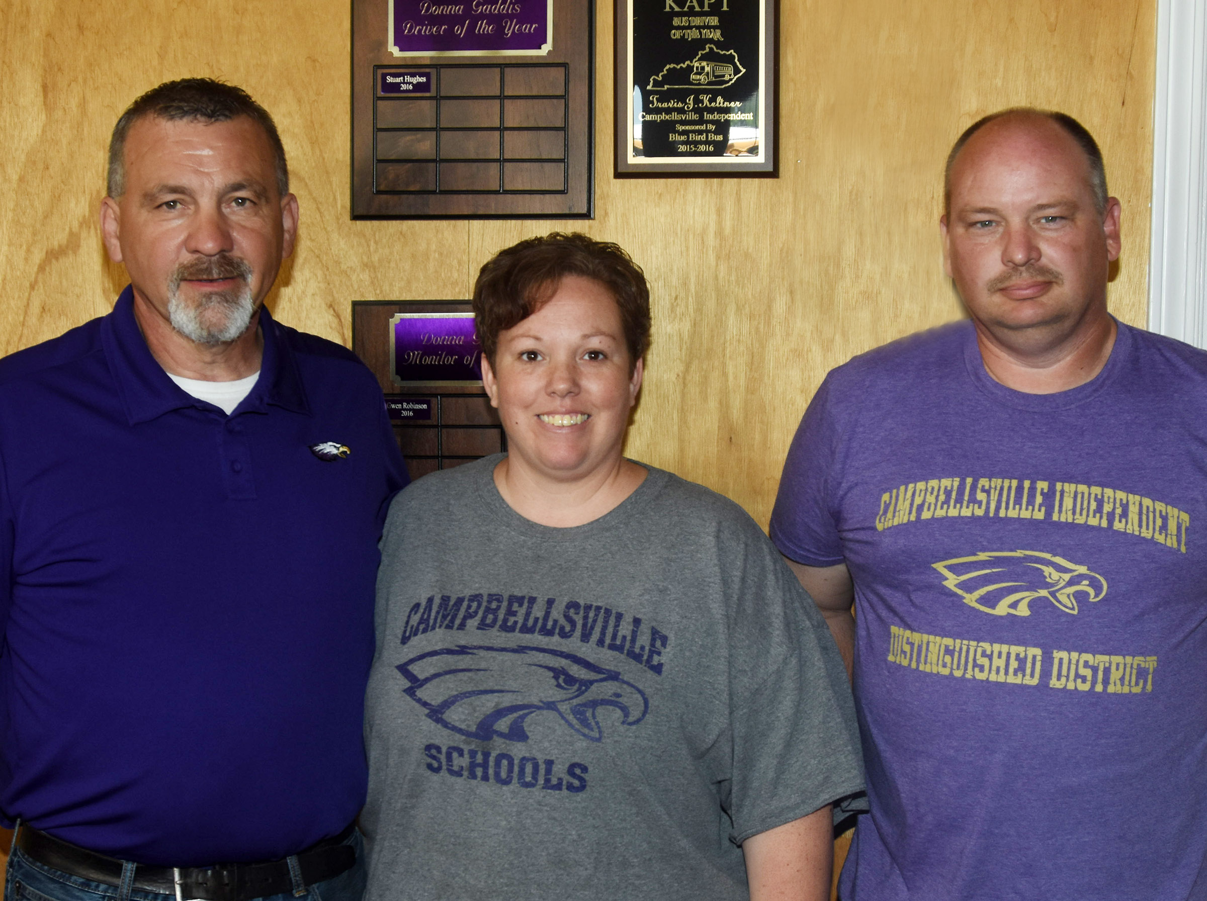 Campbellsville Independent Schools Transportation Director Tim Tungate, at left, recently honored his top bus driver and monitor. B.J. Perkins, center, received the Donna Gaddis Bus Monitor of the Year award. Stuart Hughes received the Donna Gaddis Driver of the Year award.