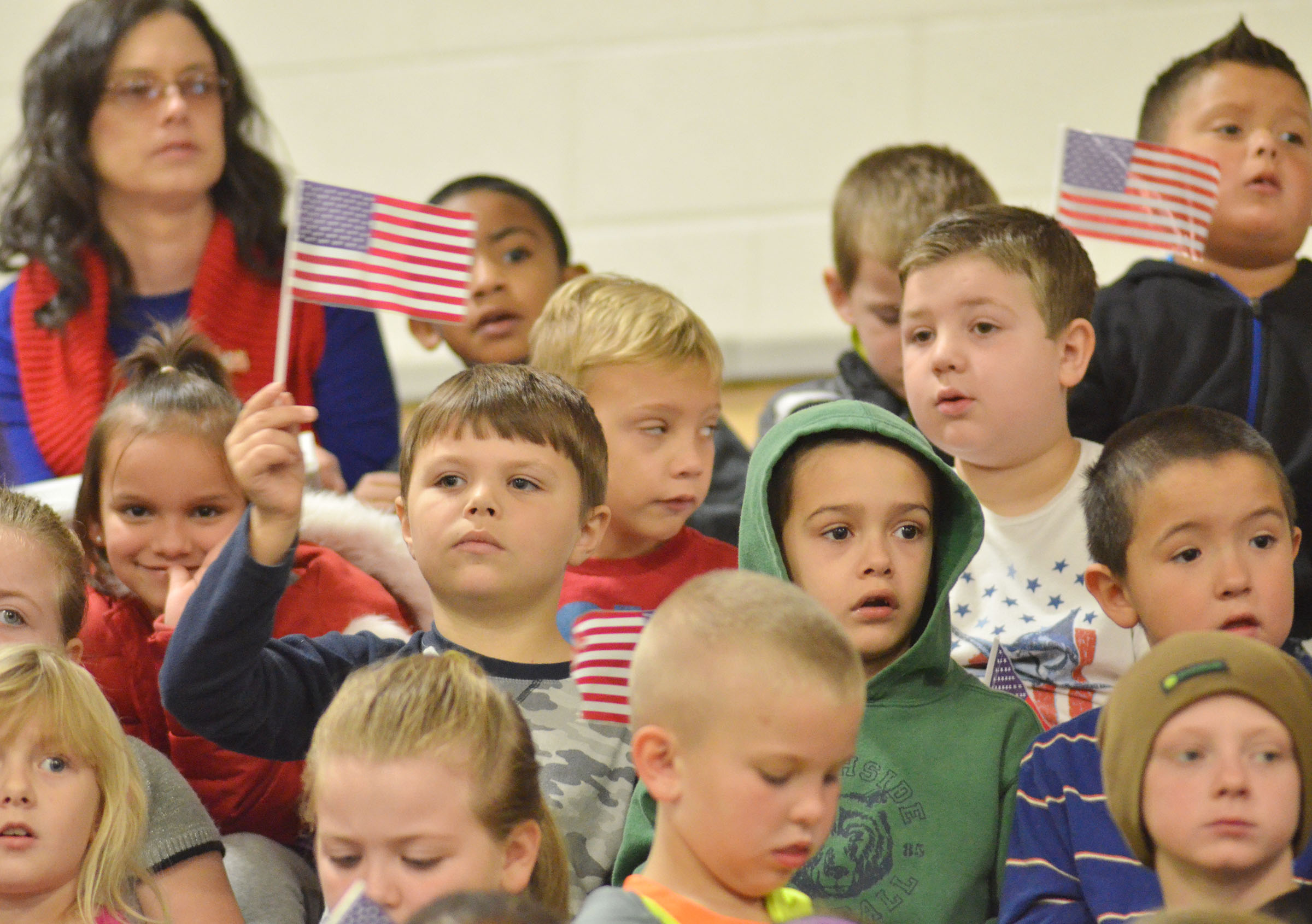 CES first-grader Jaxson Hunt waves the American flag.