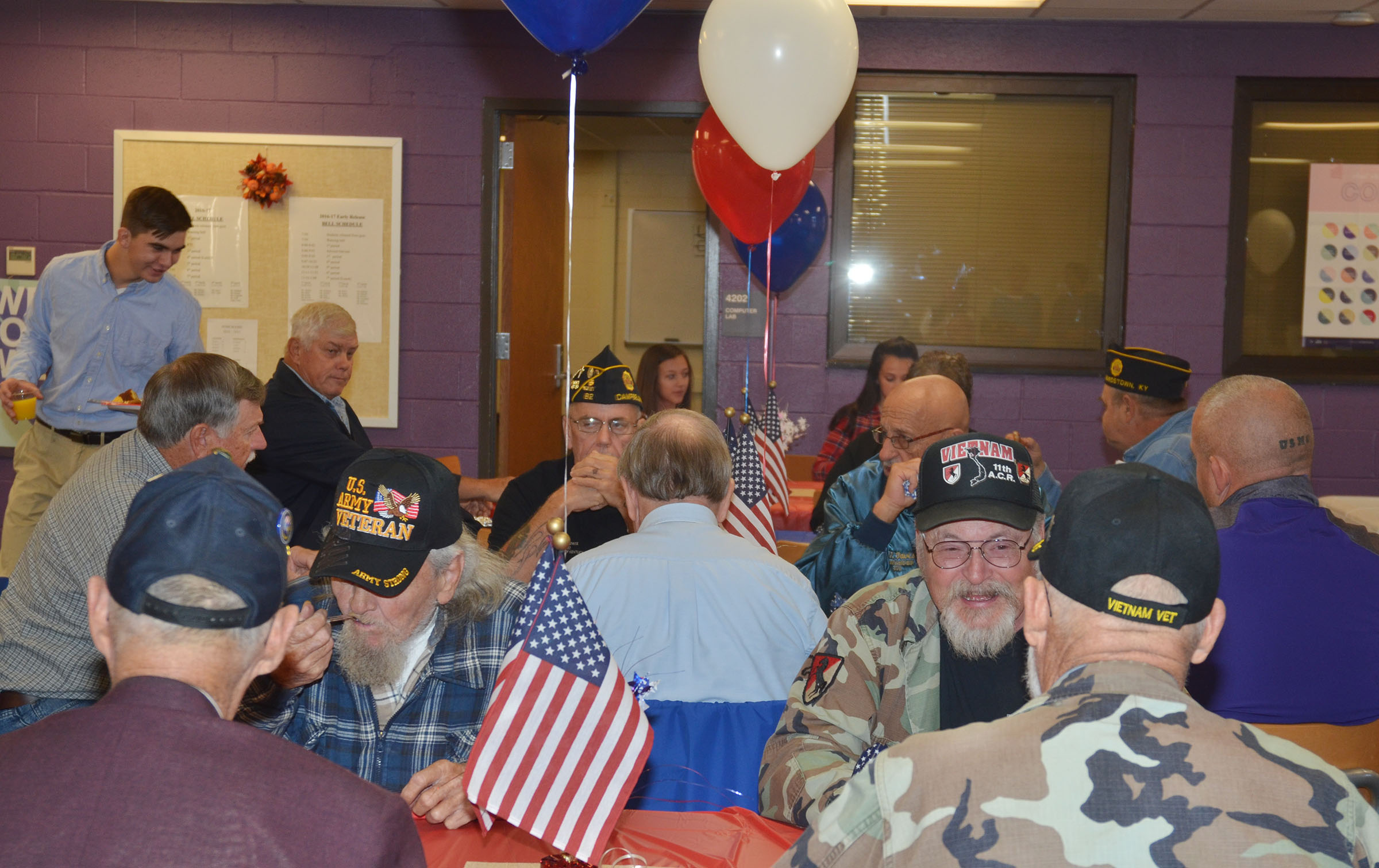 Veterans enjoy a breakfast in their honor after the ceremony.
