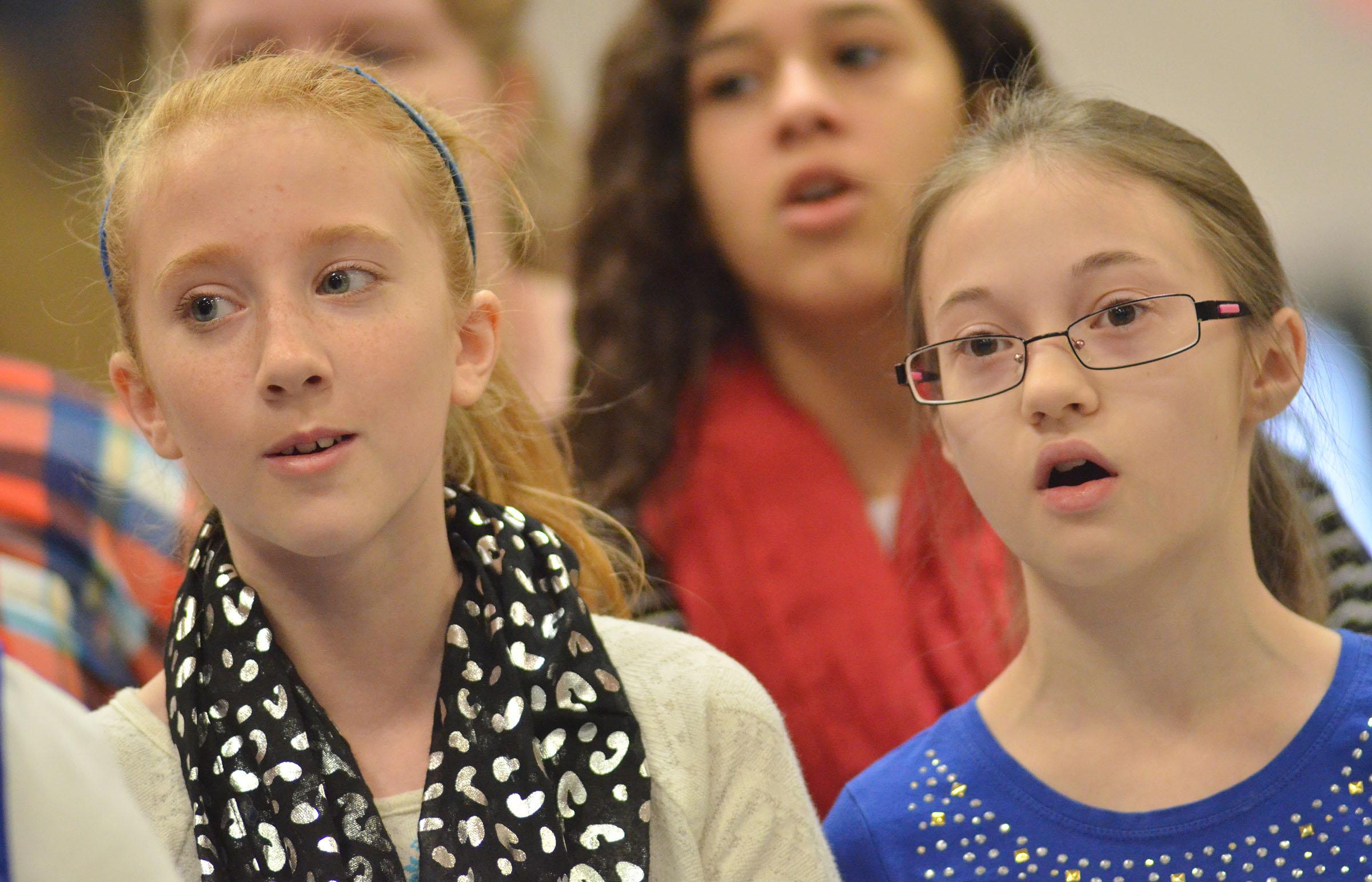 CMS fifth-grader Kaydence Wethington, at left, and seventh-grader Cailet Clark sing.