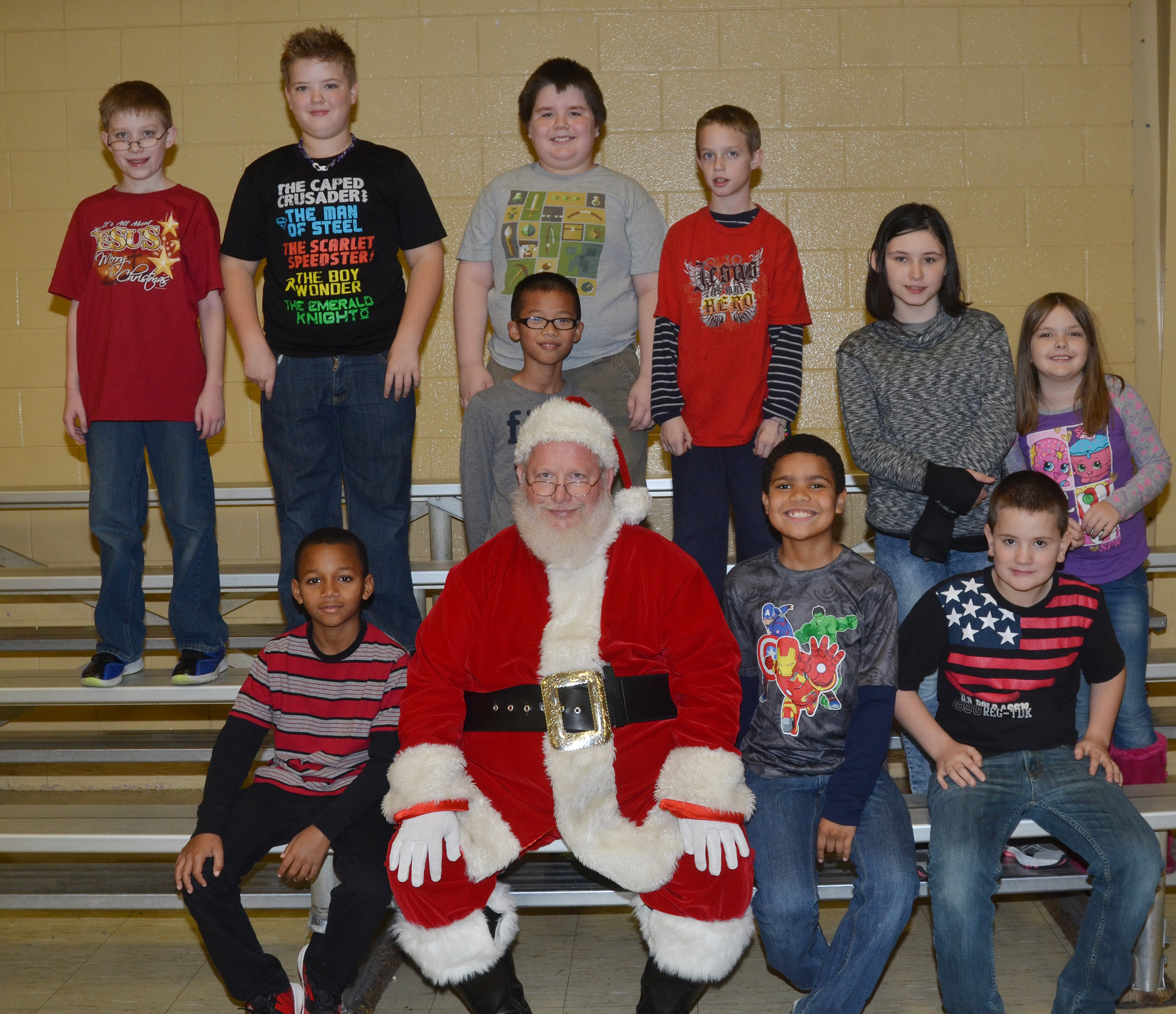 CMS fourth- and fifth-graders pose for a photo with Santa.