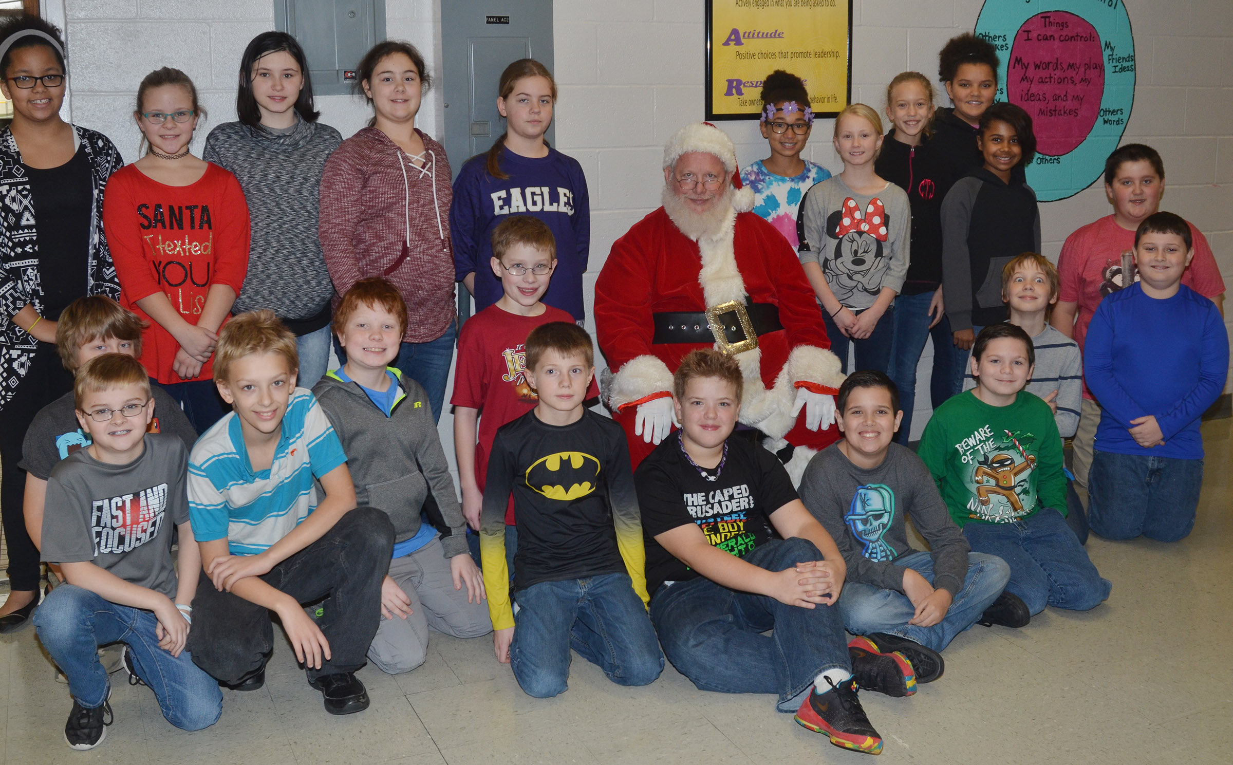CMS fifth-graders pose for a photo with Santa.