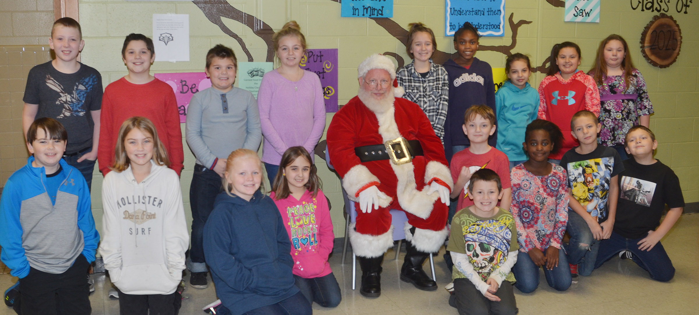 CMS fourth-graders pose for a photo with Santa.