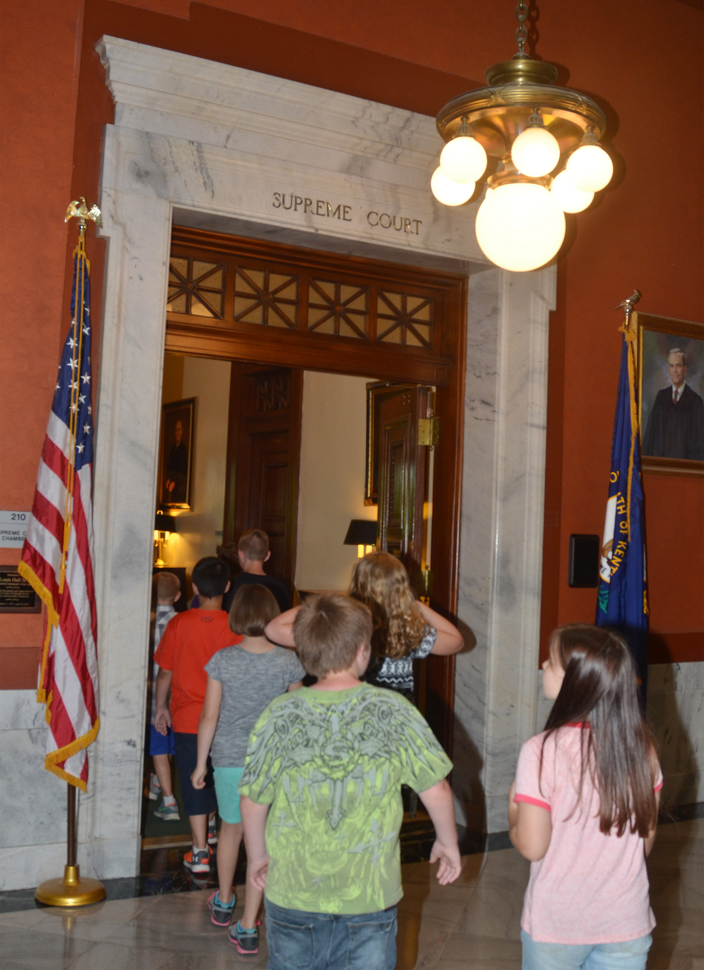 CMS fourth-graders walk in the Kentucky Supreme Court chambers.
