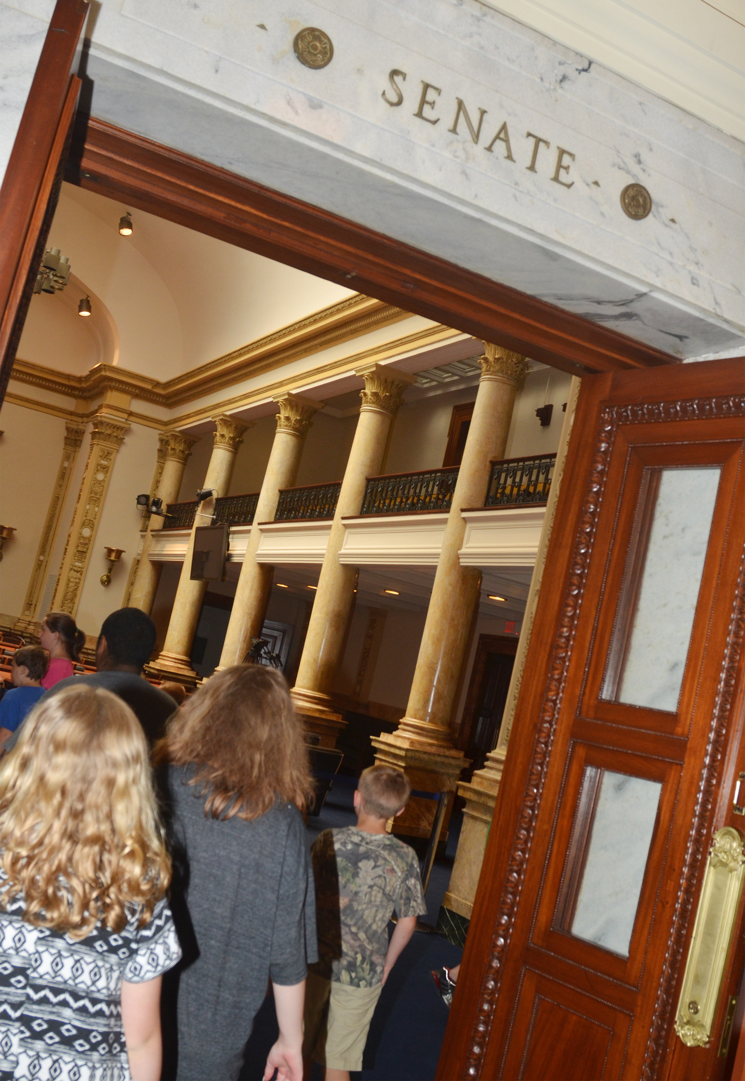 CMS fourth-graders walk into the Senate chambers.