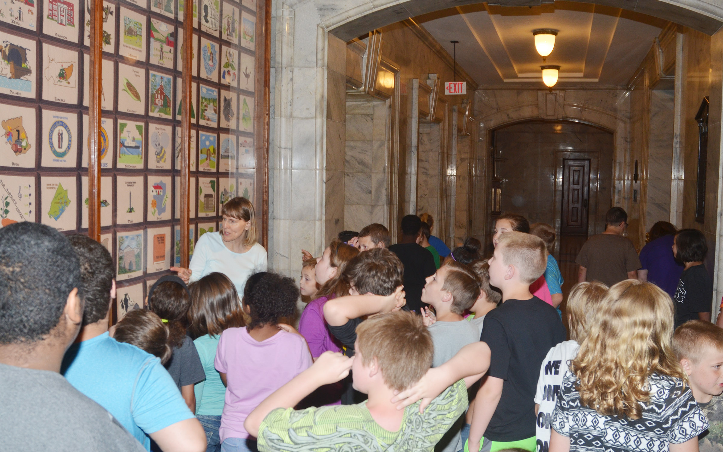 Capitol tour guide Annie Denny talks to CMS fourth-graders about the quilt made to represent all of the counties in Kentucky.