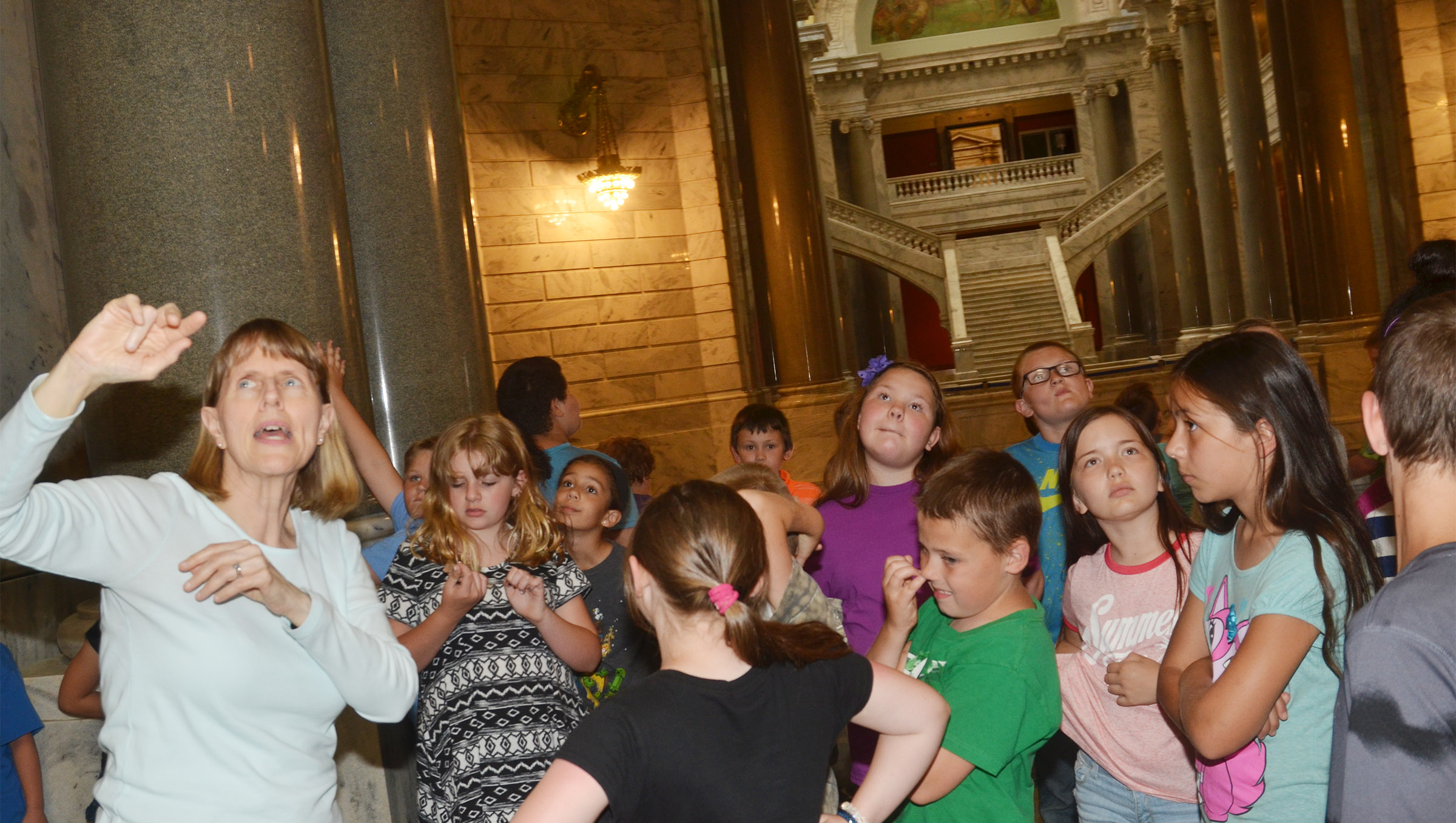 Capitol tour guide Annie Denny talks to CMS fourth-graders about the architecture of the capitol building.