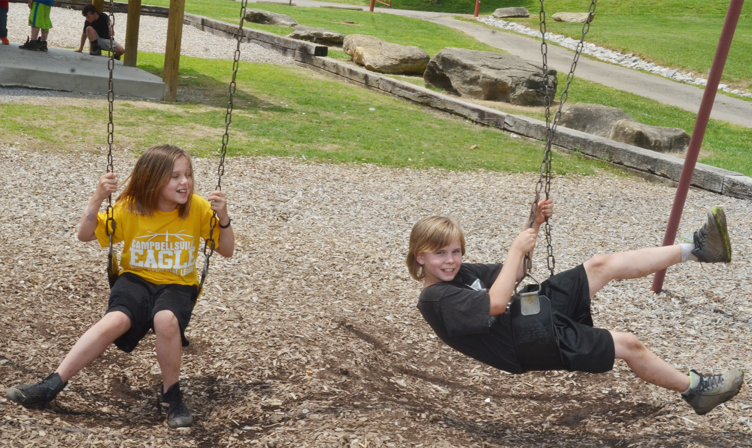 CMS fourth-graders Natasha Torres, at left, and Thomas Tungate swing.